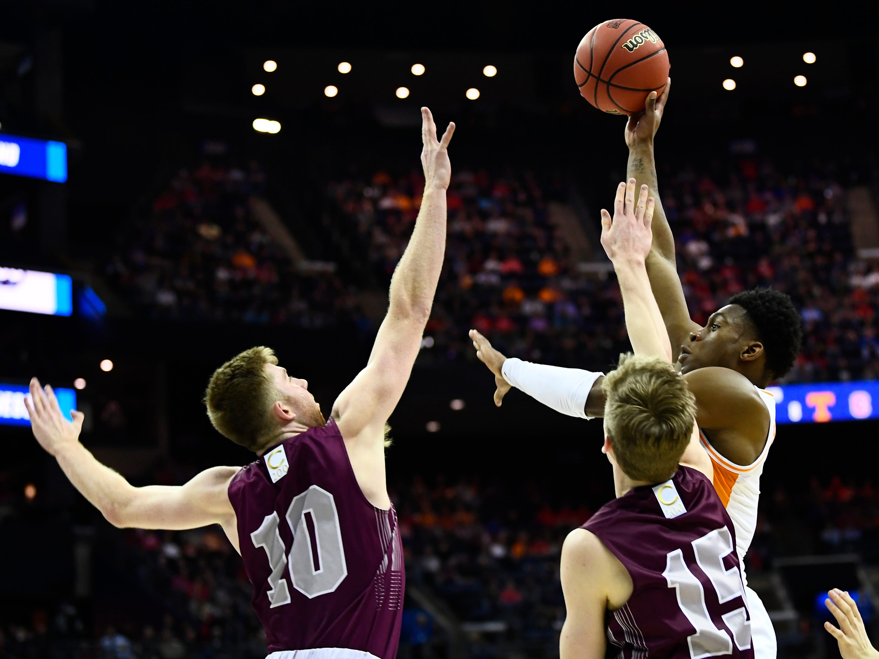 Tennessee guard Admiral Schofield (5) shoots over Colgate forward Will Rayman (10) and guard Tucker Richardson (15) during their first round game of the NCAA Tournament at Nationwide Arena in Columbus, Ohio, on Friday, March 22, 2019.