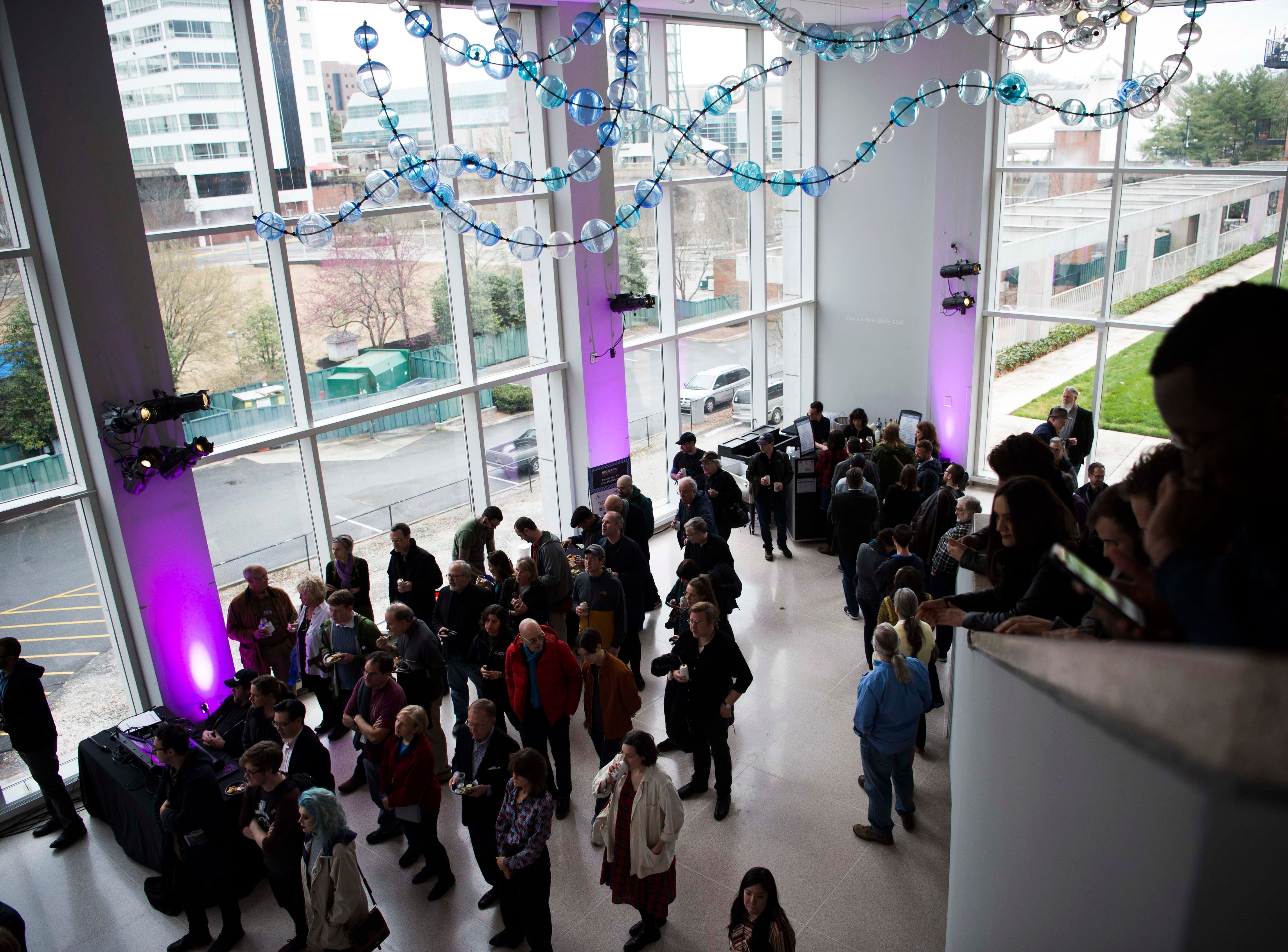 A crowd of Big Ears Festival attendees mingle in the Knoxville Museum of Art in Knoxville Thursday, March 21, 2019.