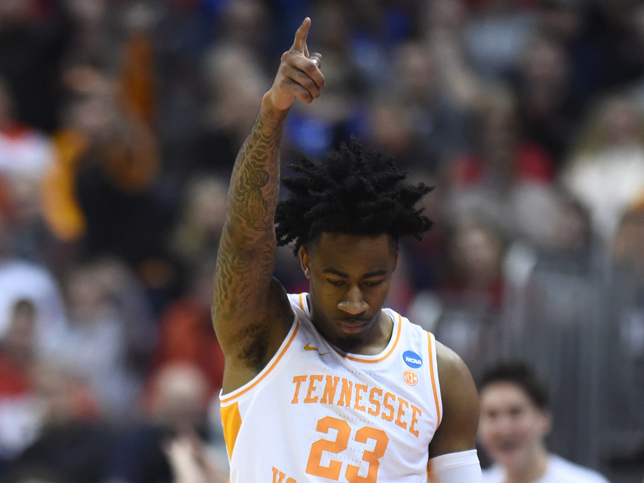 Tennessee guard Jordan Bowden (23) celebrates a call against Colgate during their first-round game of the NCAA Tournament at Nationwide Arena in Columbus, Ohio, on Friday, March 22, 2019.
