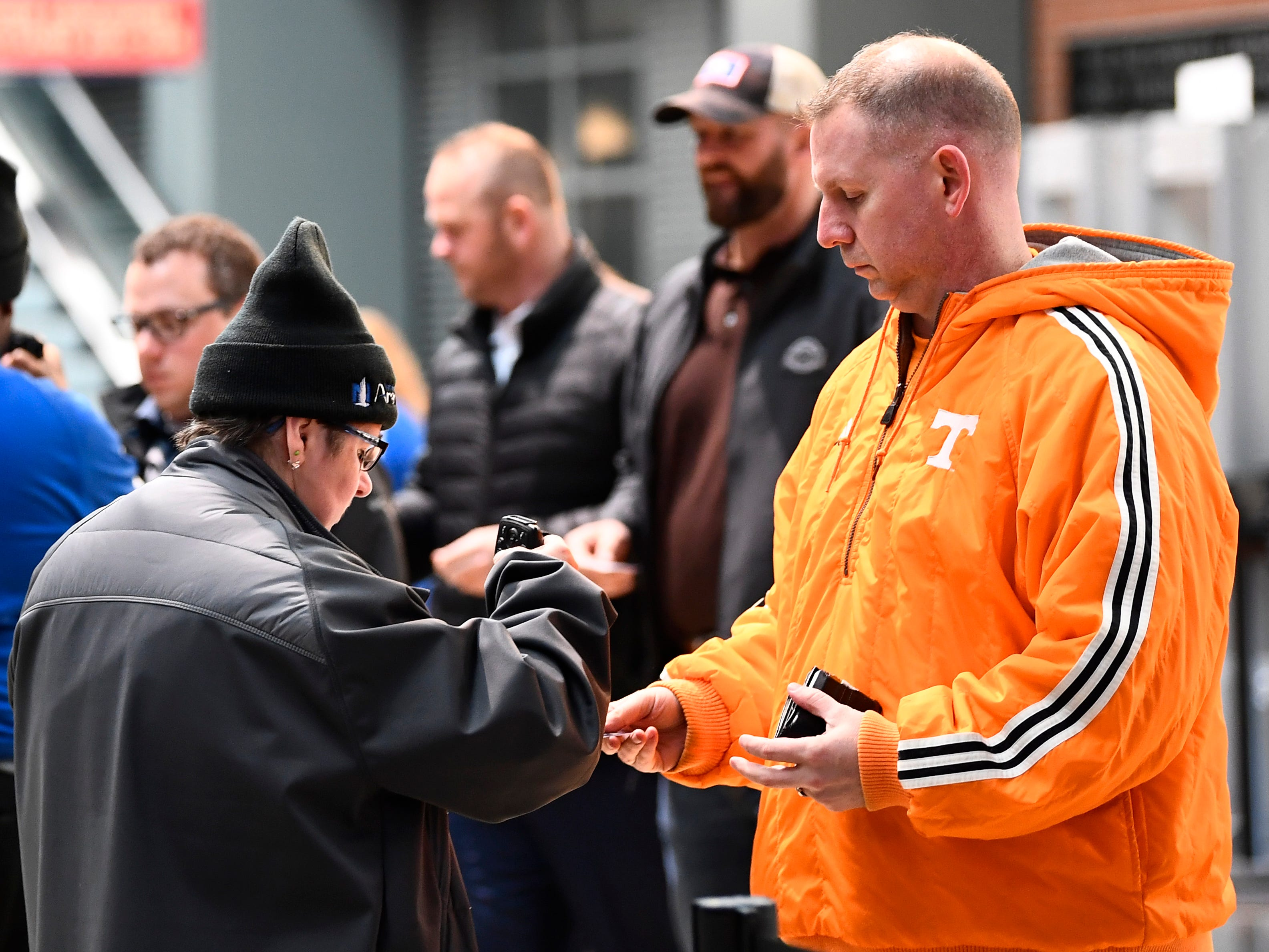 Fans have their tickets scanned before the Tennessee Volunteers' basketball game against the Colgate Raiders in the first round of the NCAA Tournament at Nationwide Arena in Columbus, Ohio, on Friday, March 22, 2019.