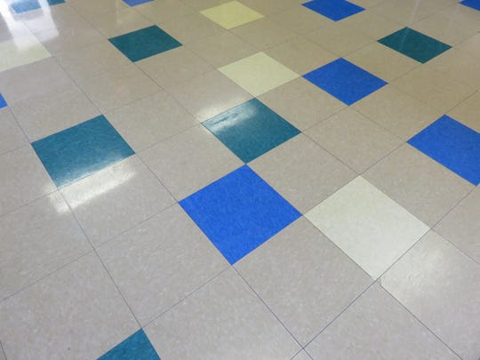 The entrance to West Hills Elementary features colorful tile patterns.