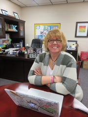 West Hills Elementary principal Kim Harrison, who is helping the school observe its 60th anniversary, is shown in her office on March 20.