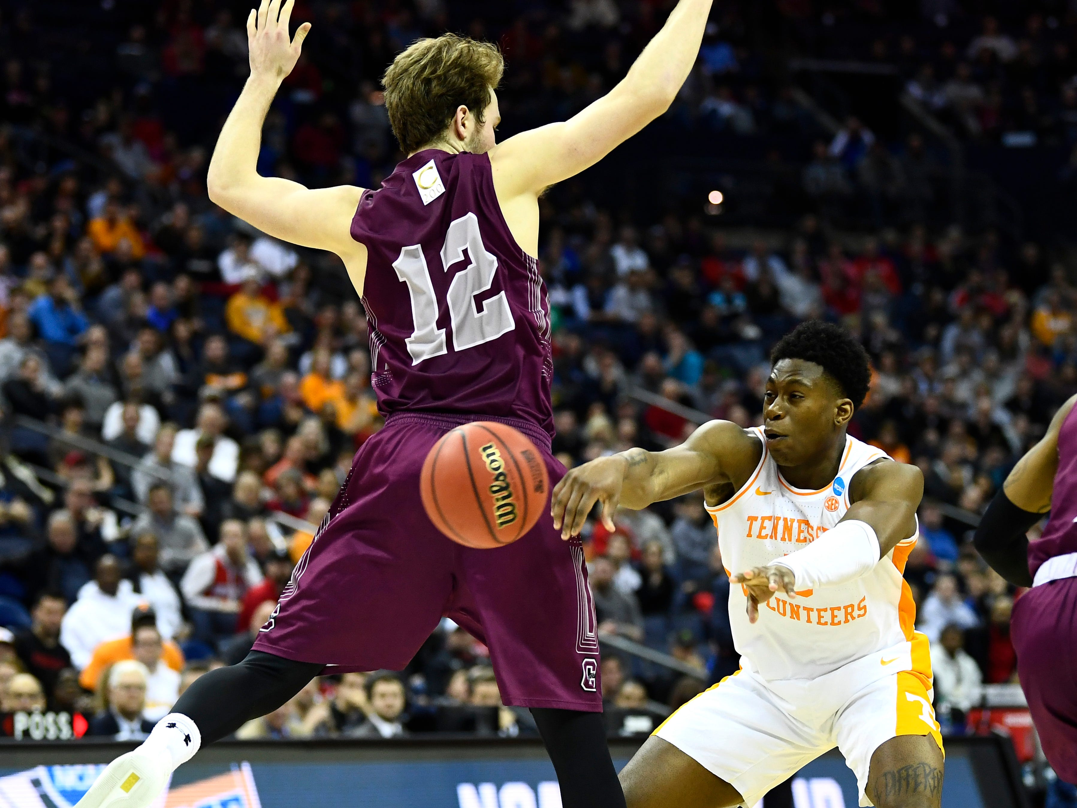Tennessee guard Admiral Schofield (5) passes defended by Colgate center Dana Batt (12) during their first round game of the NCAA Tournament at Nationwide Arena in Columbus, Ohio, on Friday, March 22, 2019.