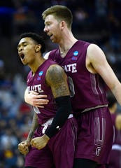 Colgate guard Jordan Burns (1) and Colgate forward Will Rayman (10) celebrate during their first round game against Tennessee in the NCAA Tournament at Nationwide Arena in Columbus, Ohio, on Friday, March 22, 2019.