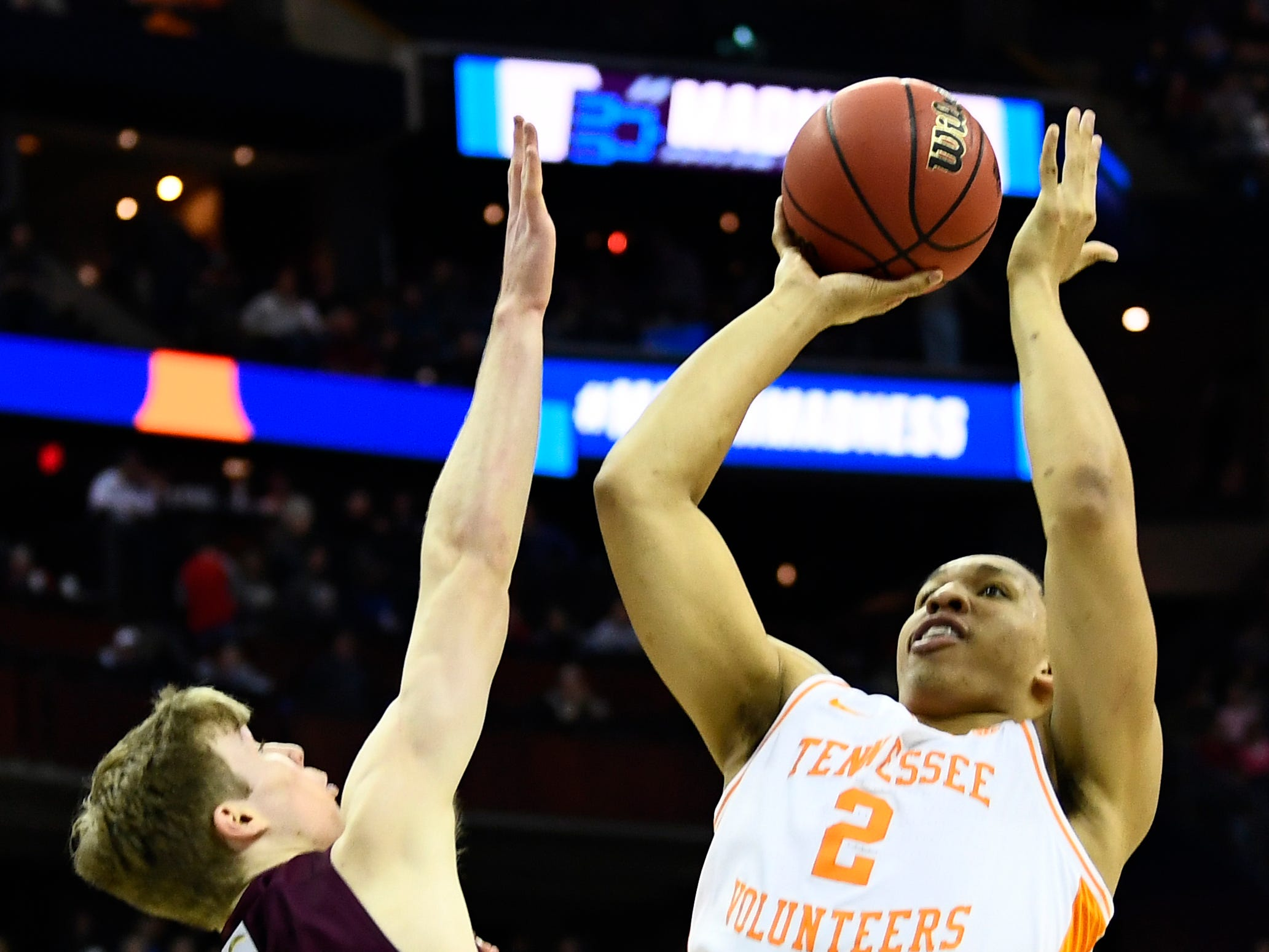 Tennessee forward Grant Williams (2) shoots over Colgate guard Tucker Richardson (15) during their first round game of the NCAA Tournament at Nationwide Arena in Columbus, Ohio, on Friday, March 22, 2019.