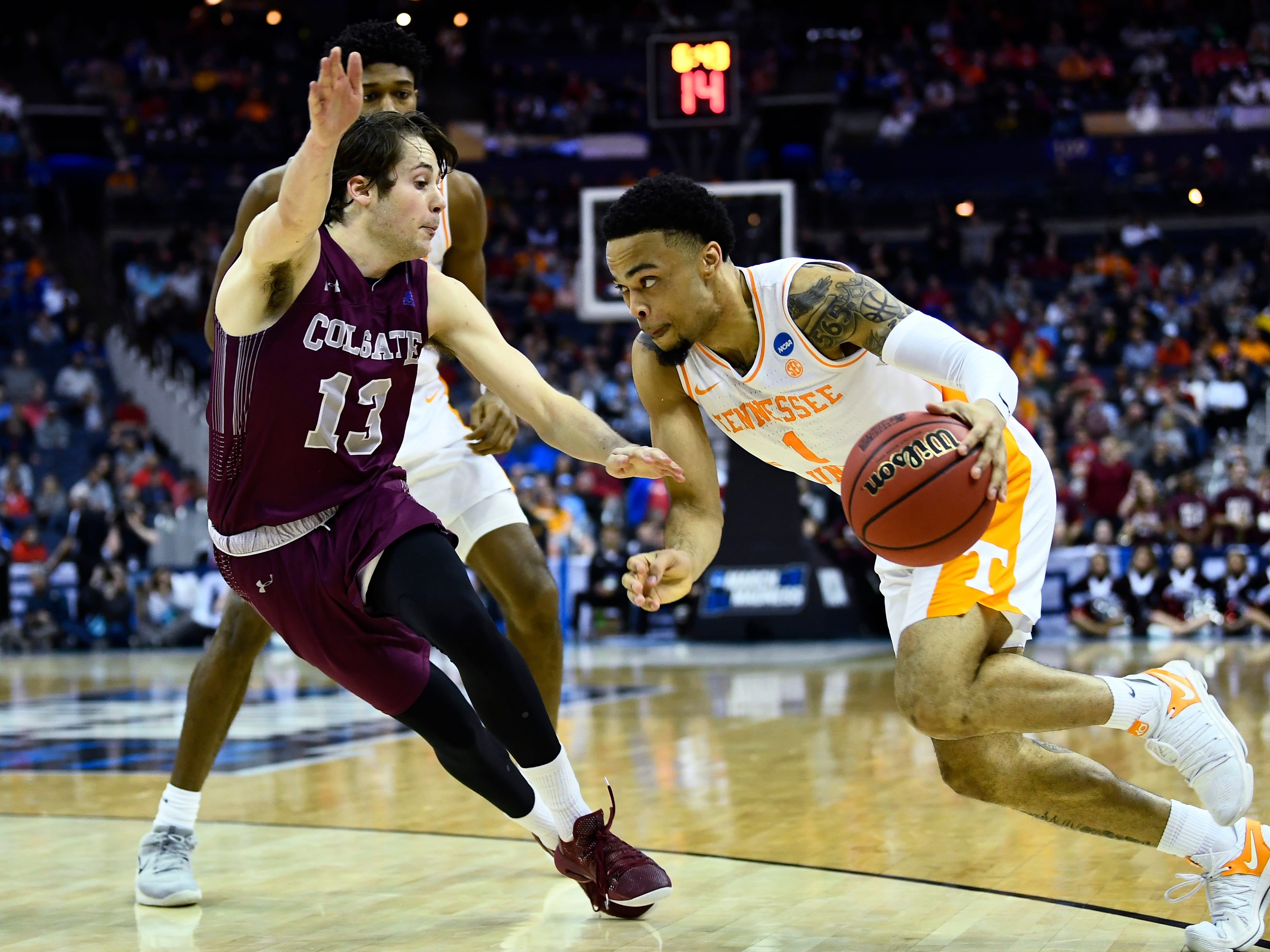 Tennessee guard Lamonte Turner (1) drives past Colgate guard Jack Ferguson (13) during their first round game of the NCAA Tournament at Nationwide Arena in Columbus, Ohio, on Friday, March 22, 2019.