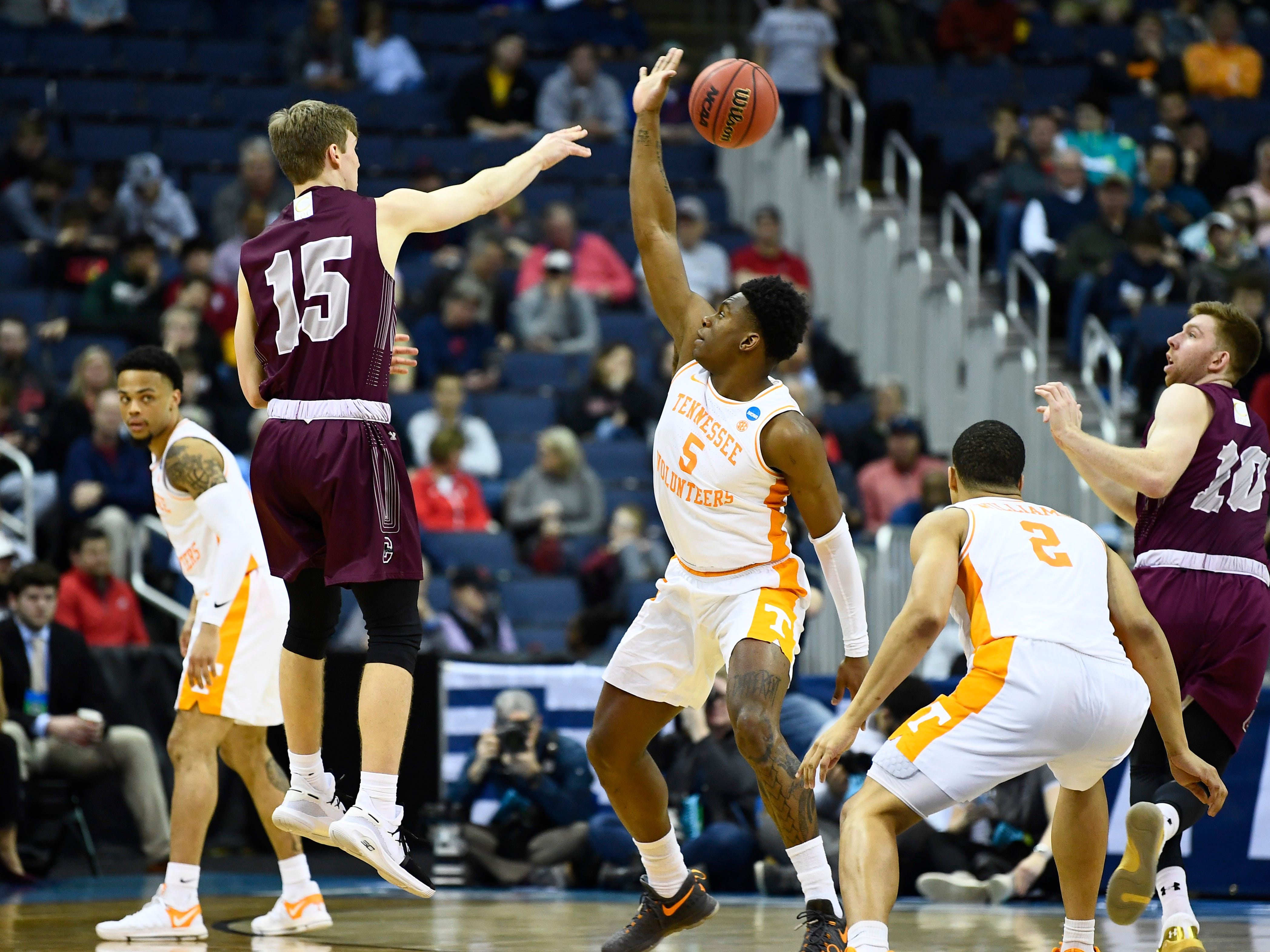 Tennessee guard Admiral Schofield (5) guards Colgate guard Tucker Richardson (15) during their first round game in the NCAA Tournament at Nationwide Arena in Columbus, Ohio, on Friday, March 22, 2019.