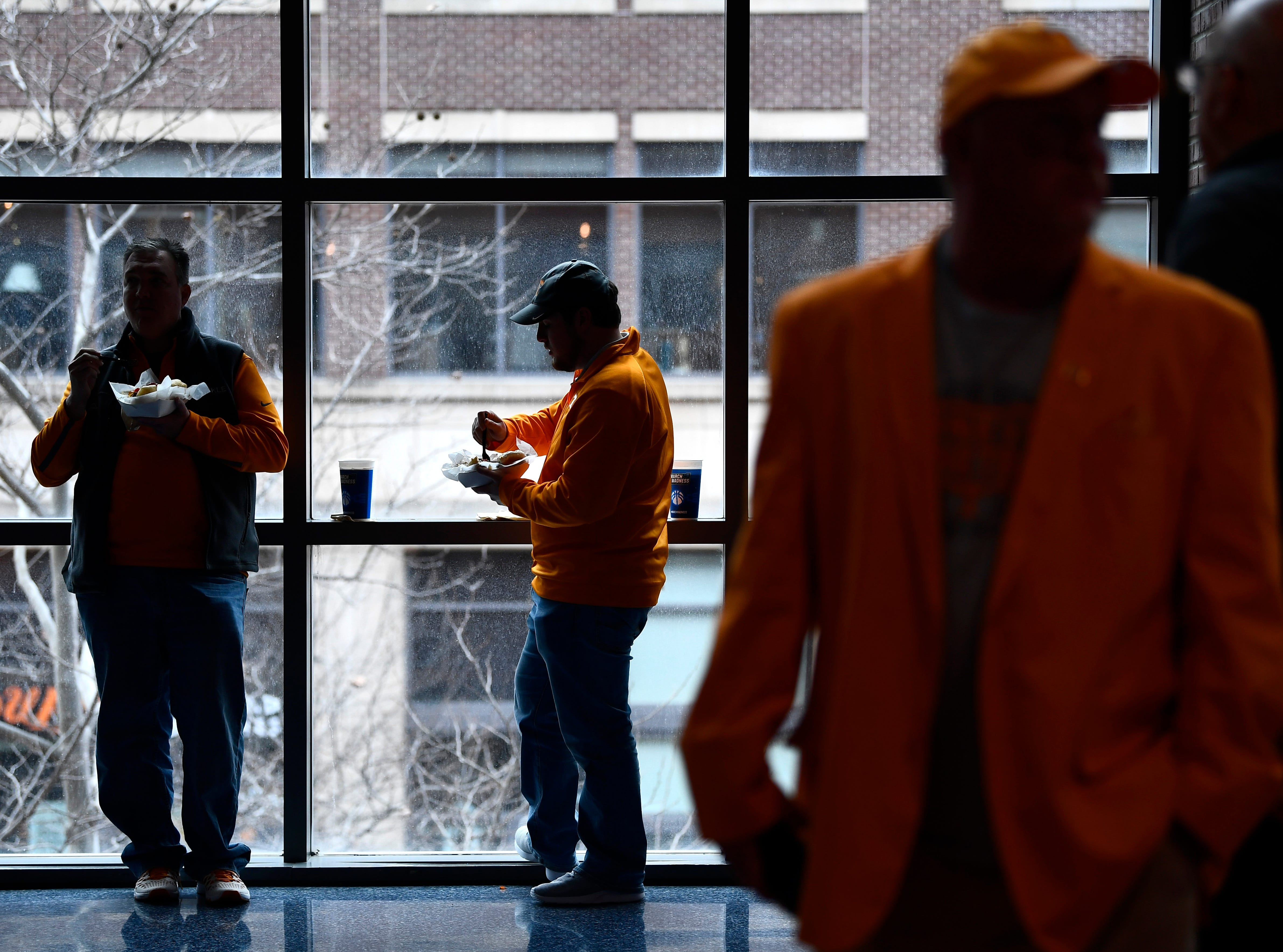 Tennessee fans mingle on the concourse before the UT basketball game against the Colgate Raiders in the first round of the NCAA Tournament at Nationwide Arena in Columbus, Ohio, on Friday, March 22, 2019.