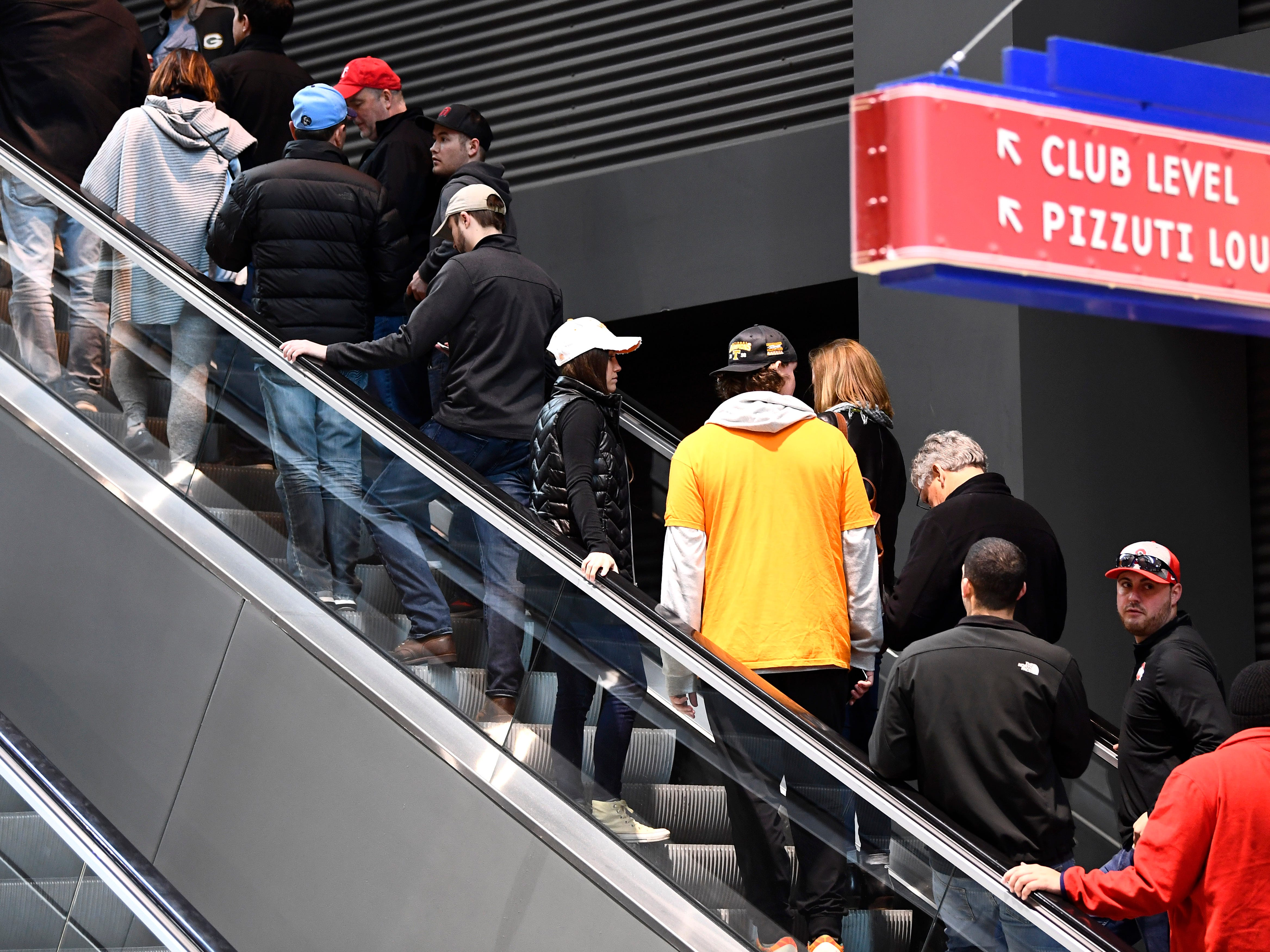 A spot of Tennessee orange on the escalator before the UT's basketball game against the Colgate Raiders in the first round of the NCAA Tournament at Nationwide Arena in Columbus, Ohio, on Friday, March 22, 2019.