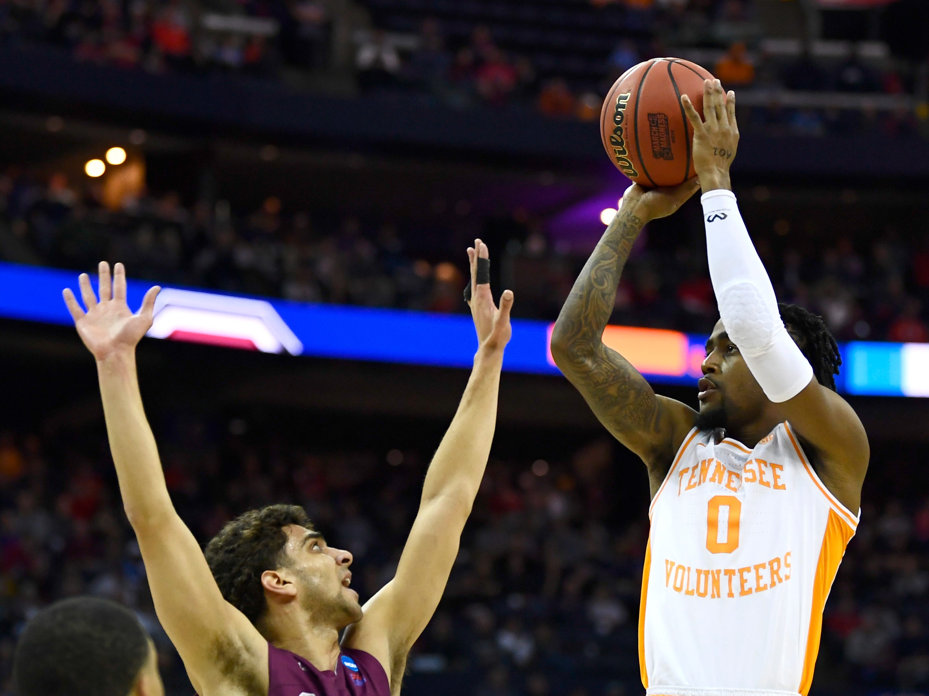 Tennessee guard Jordan Bone (0) shoots over Colgate guard Francisco Amiel (30) during their first round game of the NCAA Tournament at Nationwide Arena in Columbus, Ohio, on Friday, March 22, 2019.