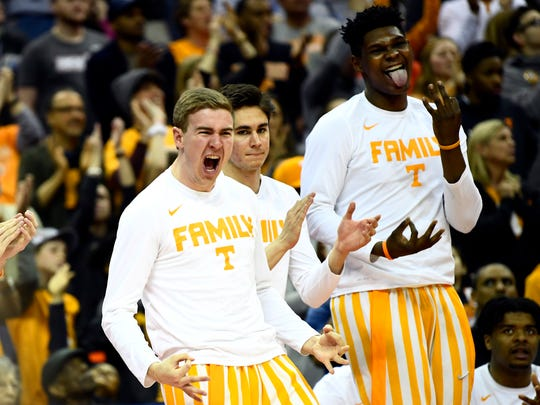 Tennessee guard Brad Woodson (12) and Tennessee forward Derrick Walker (15) celebrate a three-pointer by Tennessee guard Admiral Schofield (5) during the Tennessee VolunteersÕ basketball game against the Colgate Raiders in the first round of the NCAA Tournament held at Nationwide Arena in Columbus, Ohio, on Friday, March 22, 2019.
