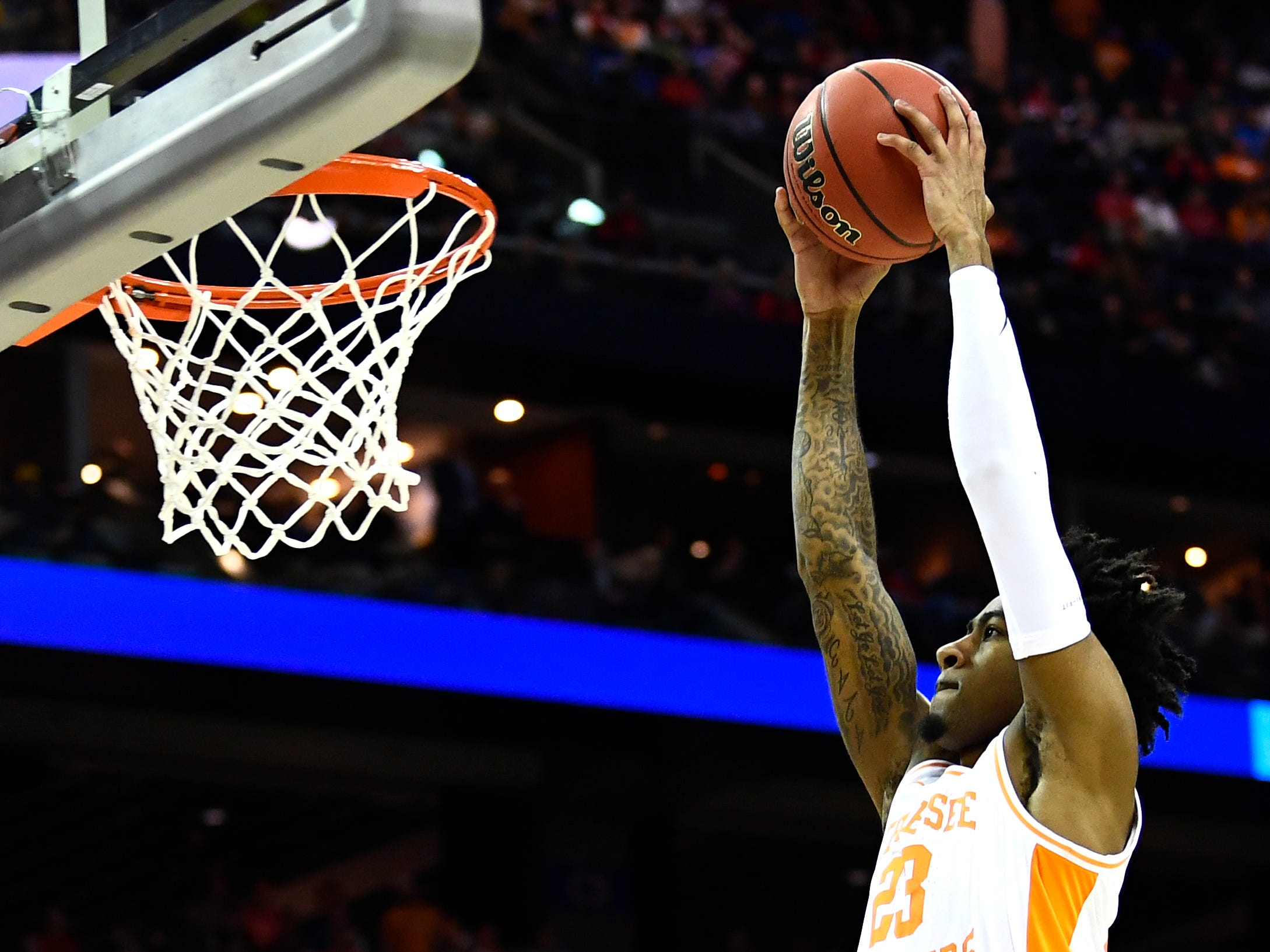Tennessee guard Jordan Bowden (23) goes in for a dunk against the Colgate Raiders in the first round of the NCAA Tournament at Nationwide Arena in Columbus, Ohio, on Friday, March 22, 2019.