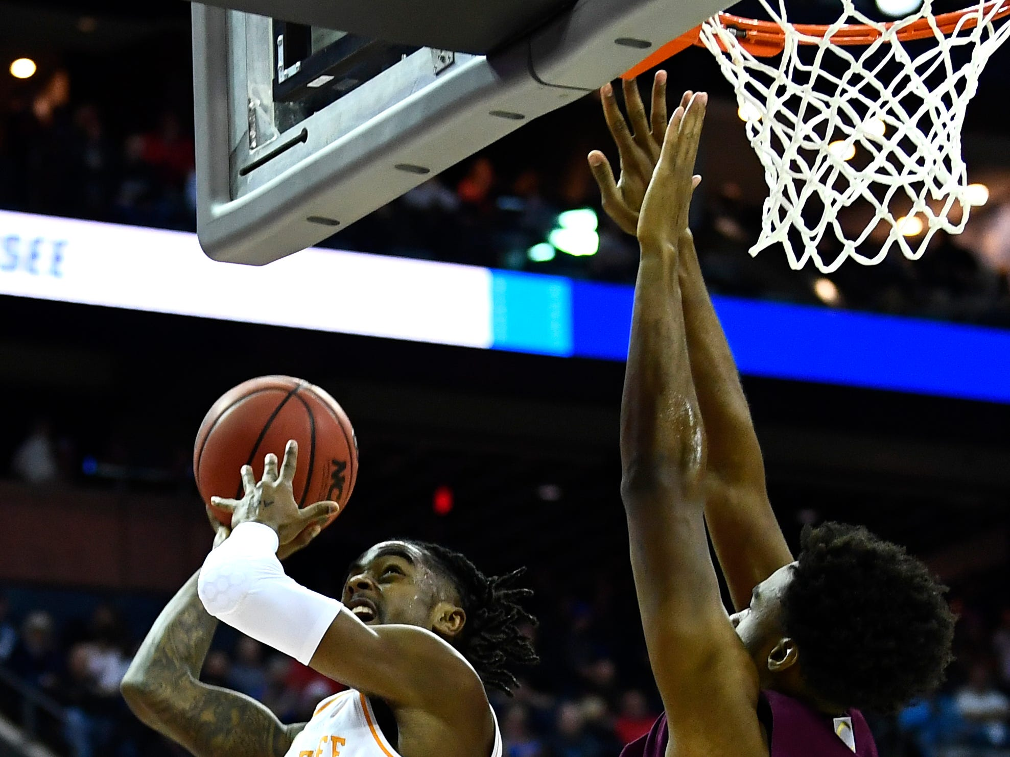 Tennessee guard Jordan Bone (0) goes for a layup defended by Colgate forward Malcolm Regisford (5) during their first round game in the NCAA Tournament at Nationwide Arena in Columbus, Ohio, on Friday, March 22, 2019.