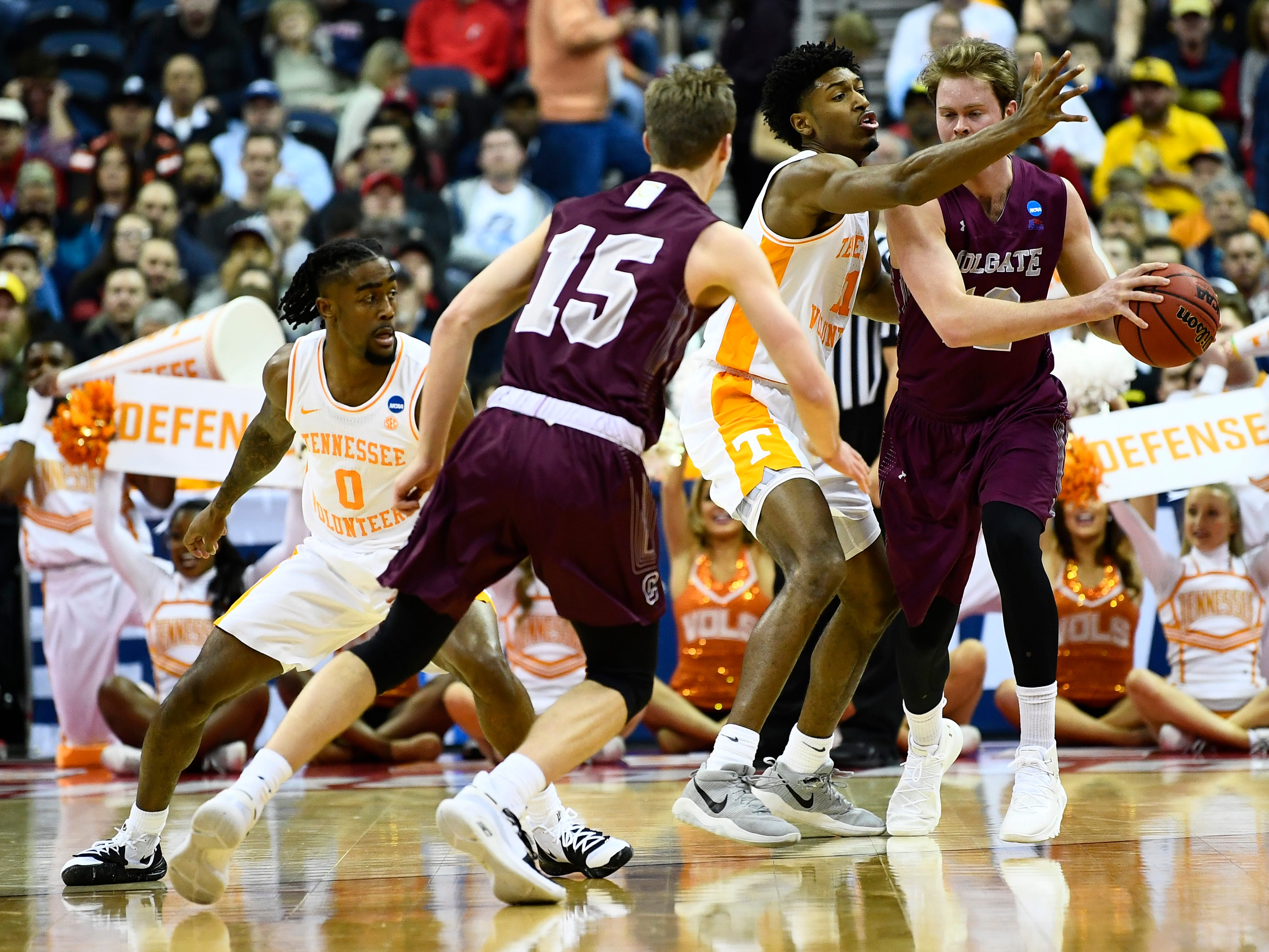 Tennessee forward Kyle Alexander (11) defends Colgate center Dana Batt (12) during the first round game of the NCAA Tournament at Nationwide Arena in Columbus, Ohio, on Friday, March 22, 2019.