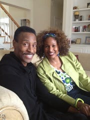 Mike Cofer poses for a photo with his wife, Reba, at their home in Fayetteville, Ga., on March 3, 2013. Cofer is a Knoxville native who played football at the University of Tennessee and went on to a 10-year career in the NFL, all with the Detroit Lions.