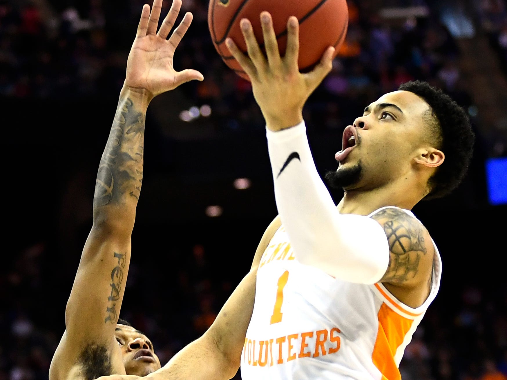 Tennessee guard Lamonte Turner (1) shoots for two over Colgate guard Jordan Burns (1) during the first round game of the NCAA Tournament at Nationwide Arena in Columbus, Ohio, on Friday, March 22, 2019.