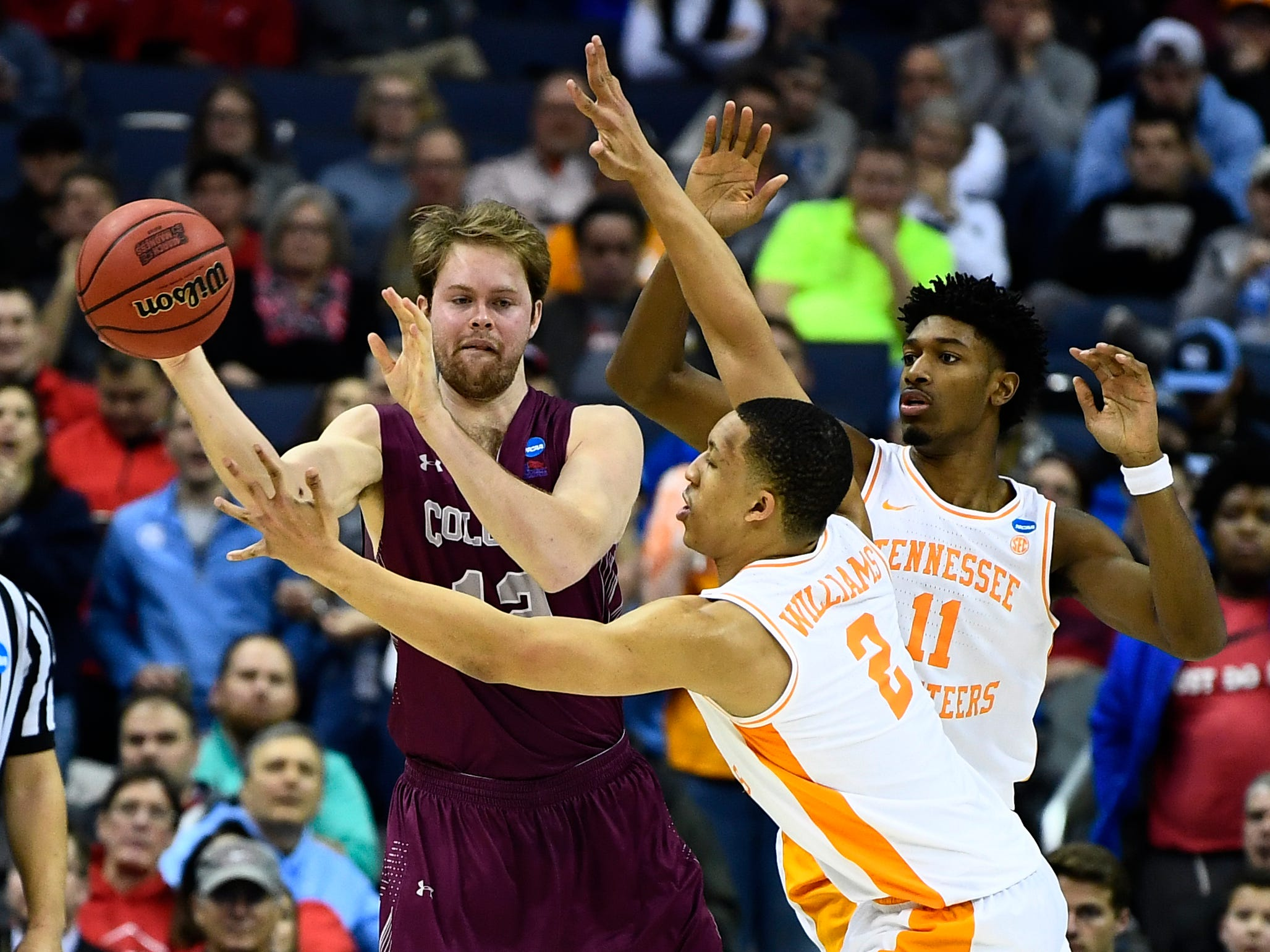 Colgate center Dana Batt (12) is surrounded by Tennessee forward Grant Williams (2) and forward Kyle Alexander (11) during their first round game in the NCAA Tournament at Nationwide Arena in Columbus, Ohio, on Friday, March 22, 2019.