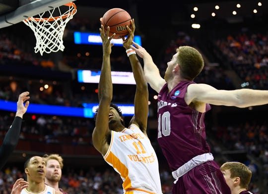 Tennessee forward Kyle Alexander (11) fights for a rebound with Colgate forward Will Rayman (10) during the first round game of the NCAA Tournament at Nationwide Arena in Columbus, Ohio, on Friday, March 22, 2019.