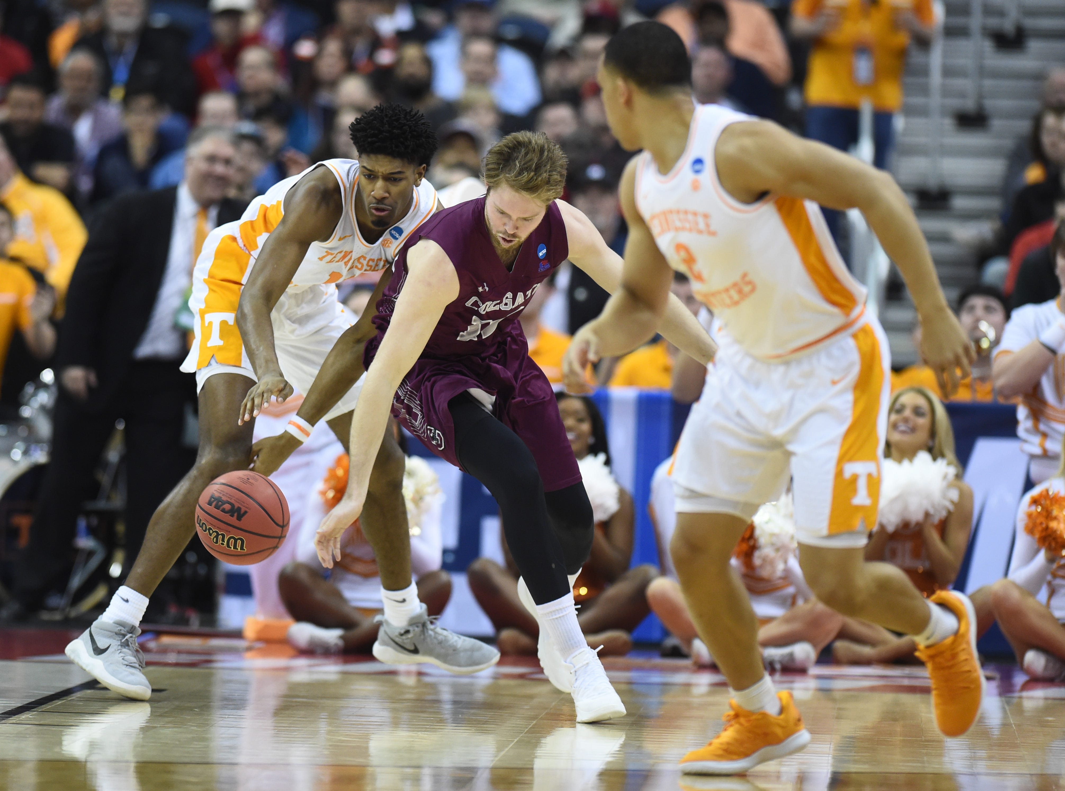 Tennessee forward Kyle Alexander (11) defends against Colgate center Dana Batt (12) during the first round of the NCAA Tournament at Nationwide Arena in Columbus, Ohio, on Friday, March 22, 2019.