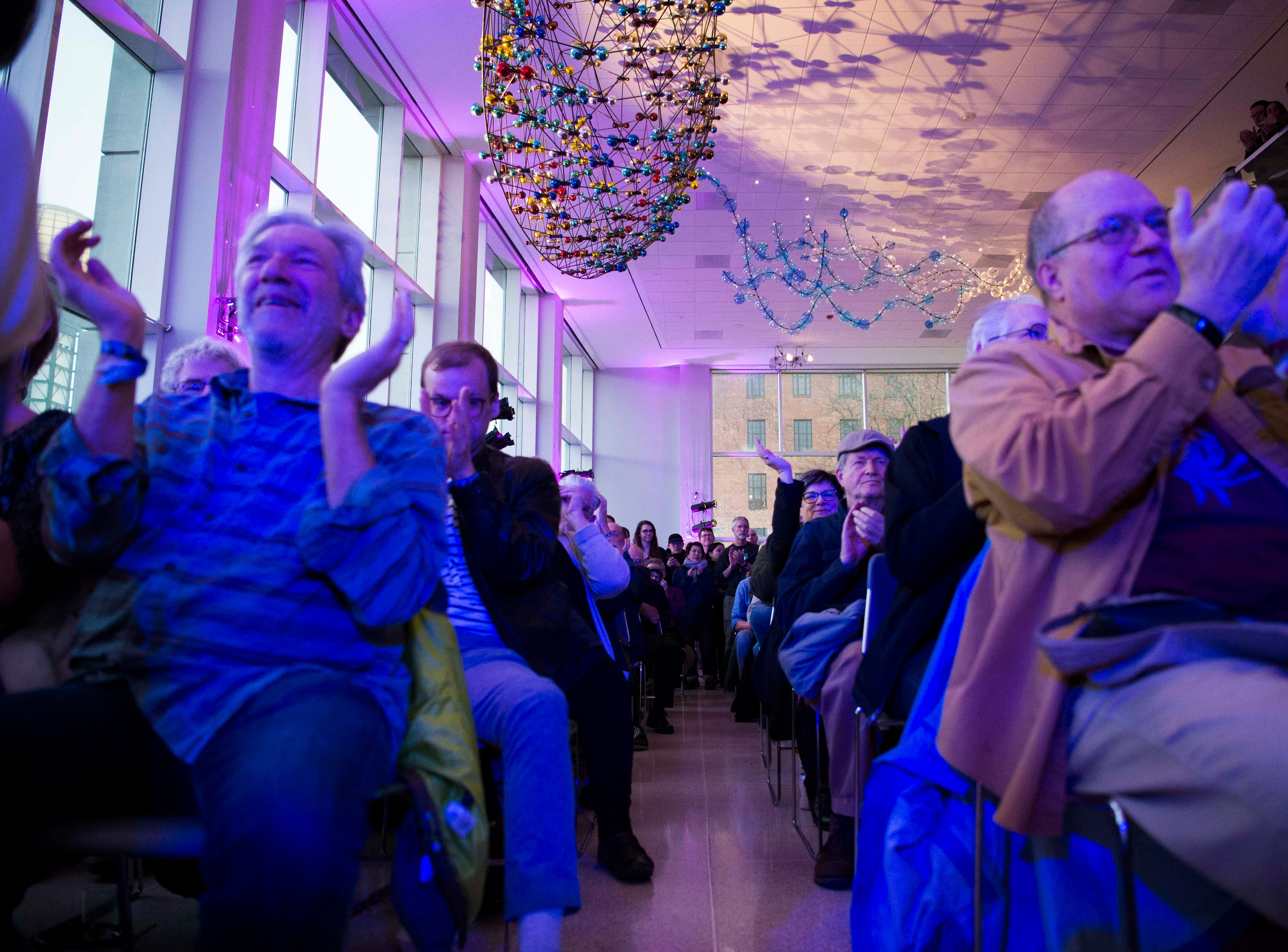 Attendees clap at the end of a song performed by Roomful of Teeth in the Knoxville Museum of Art in Knoxville Thursday, March 21, 2019.