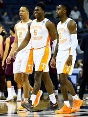 Tennessee forward Grant Williams (2) and guards Admiral Schofield (5) and Jordan Bone (0) walk to the bench during a timeout late in the game against Colgate in the first round of the NCAA Tournament on March 22.