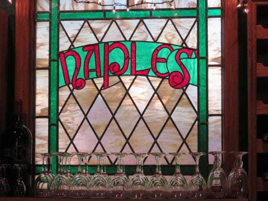 A Naples stained-glass window inside bar of restaurant. March 2019