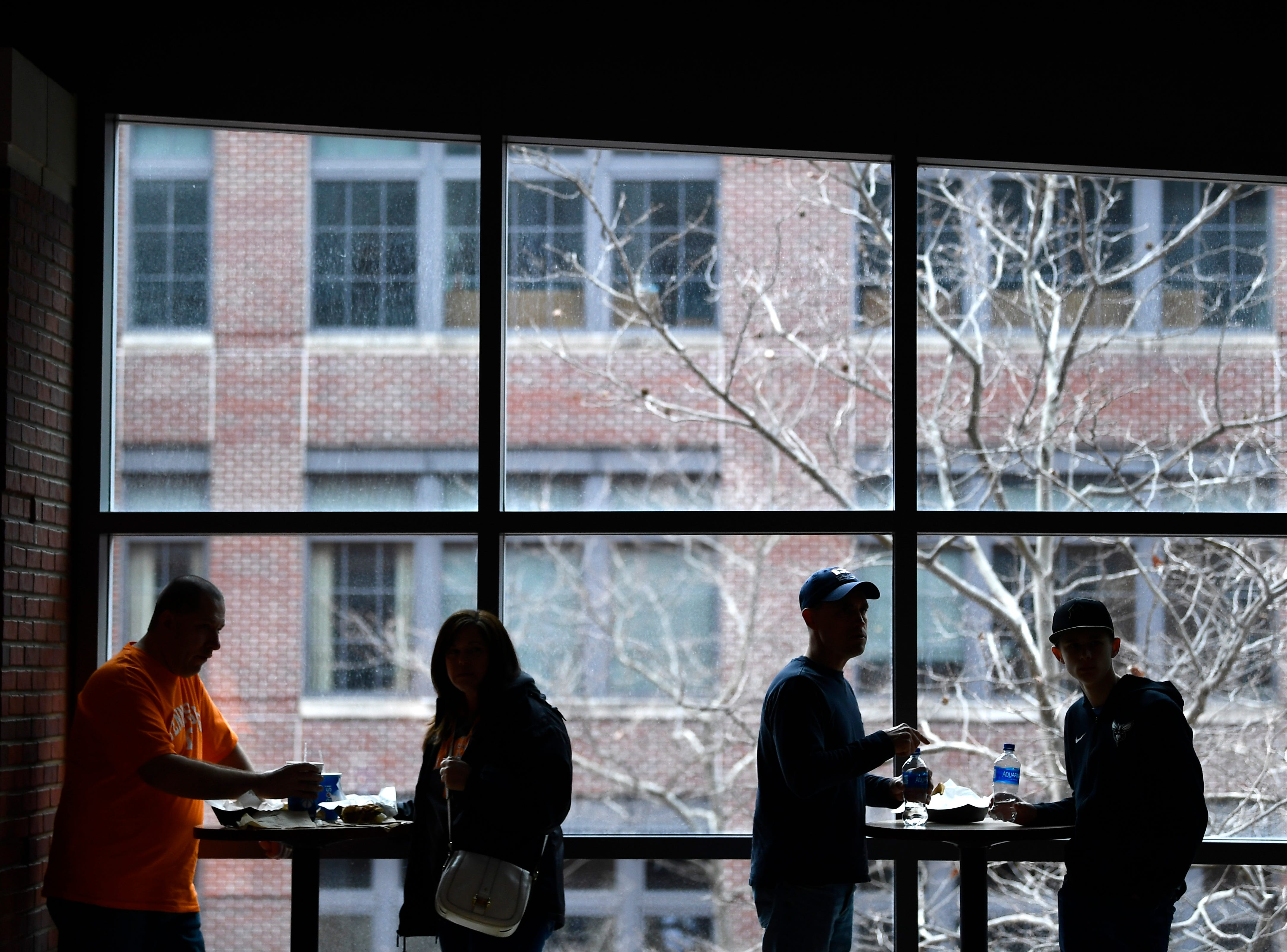 Fans eat on the concourse before the Tennessee Volunteers' basketball game against the Colgate Raiders in the first round of the NCAA Tournament at Nationwide Arena in Columbus, Ohio, on Friday, March 22, 2019.