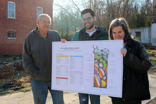 Bob Riehl, microbiologist David Talmy and Rev. Jenny Arthur in front of the butterfly garden on Sevier Avenue.