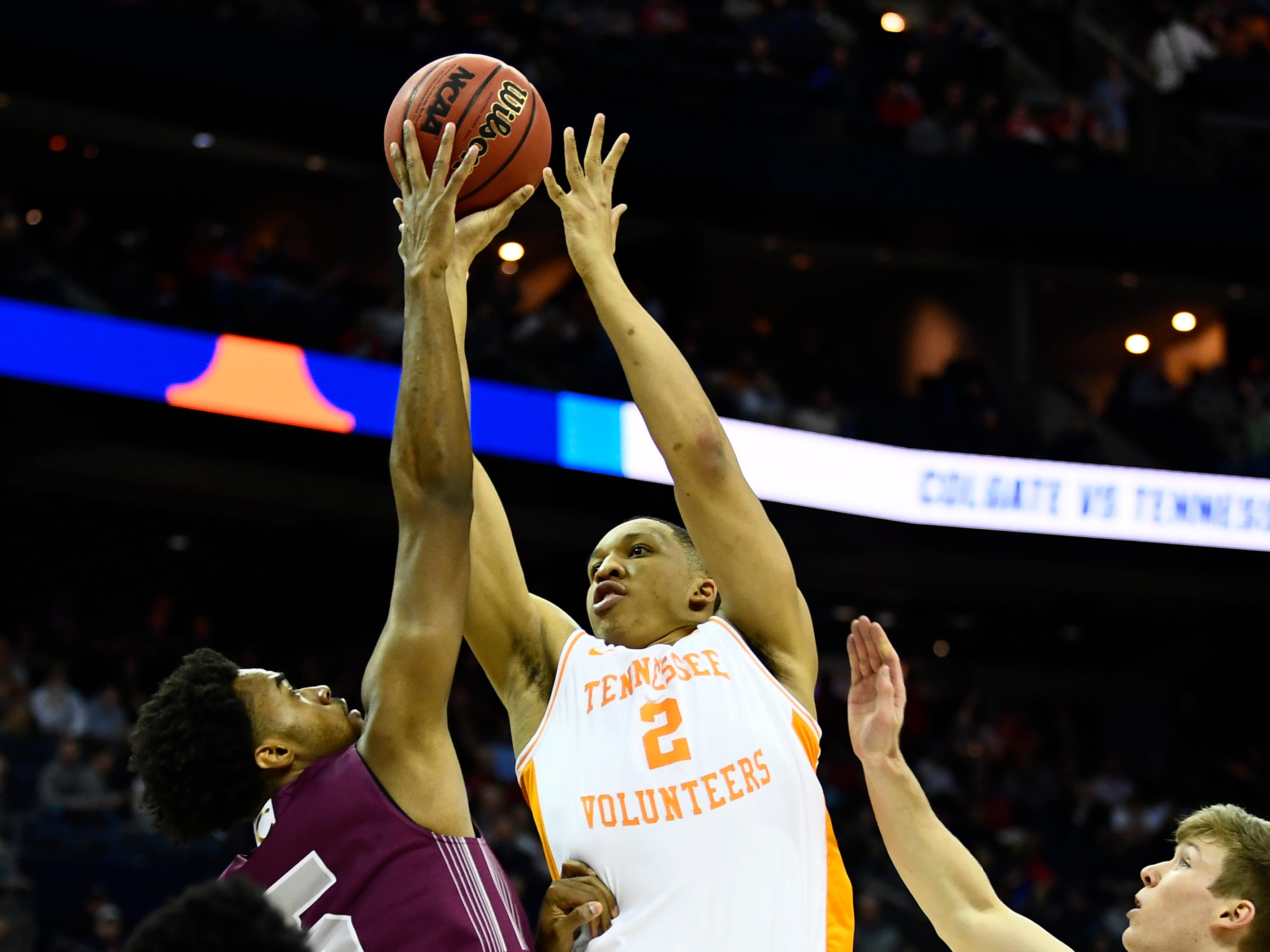 Colgate forward Malcolm Regisford (5) blocks a shot by Tennessee forward Grant Williams (2) during their first round game of the NCAA Tournament at Nationwide Arena in Columbus, Ohio, on Friday, March 22, 2019.