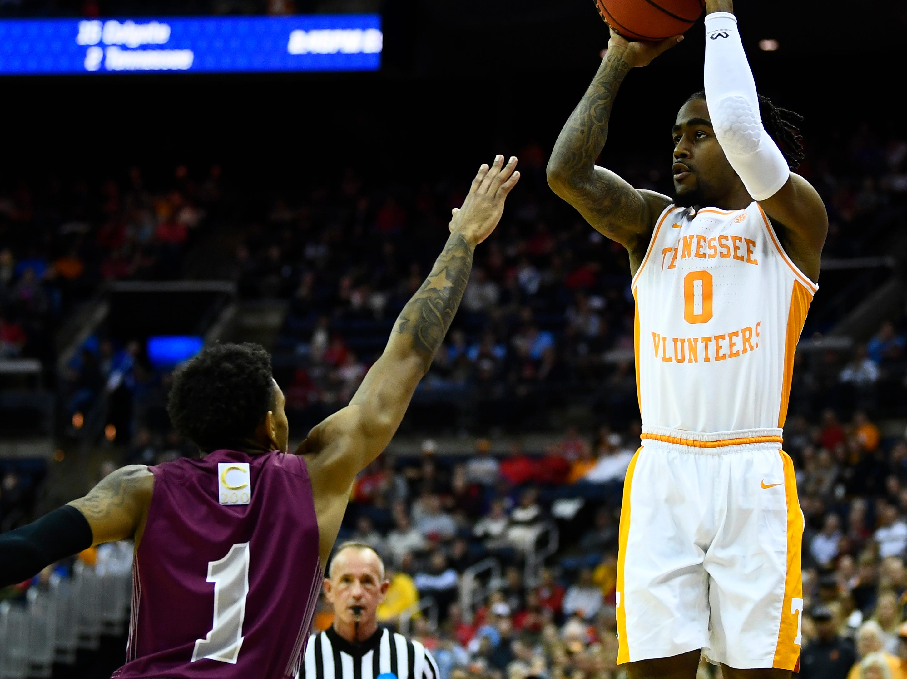 Tennessee guard Jordan Bone (0) shoots for three over Colgate guard Jordan Burns (1) in the first round of the NCAA Tournament at Nationwide Arena in Columbus, Ohio, on Friday, March 22, 2019.