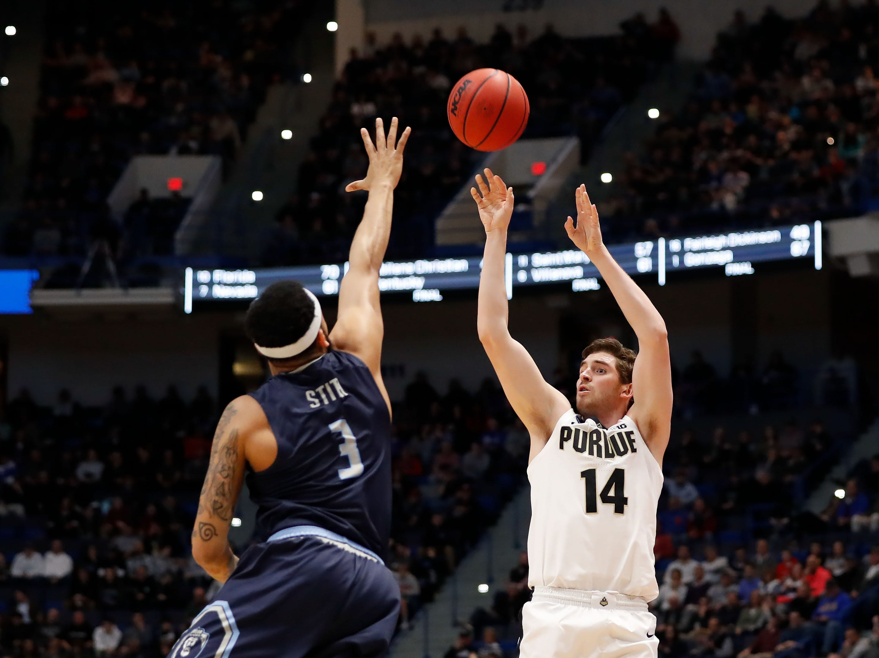 Mar 21, 2019; Hartford, CT, USA; Purdue Boilermakers guard Ryan Cline (14) attempts a shot over Old Dominion Monarchs guard B.J. Stith (3) during the first half of a game in the first round of the 2019 NCAA Tournament at XL Center. Mandatory Credit: David Butler II-USA TODAY Sports