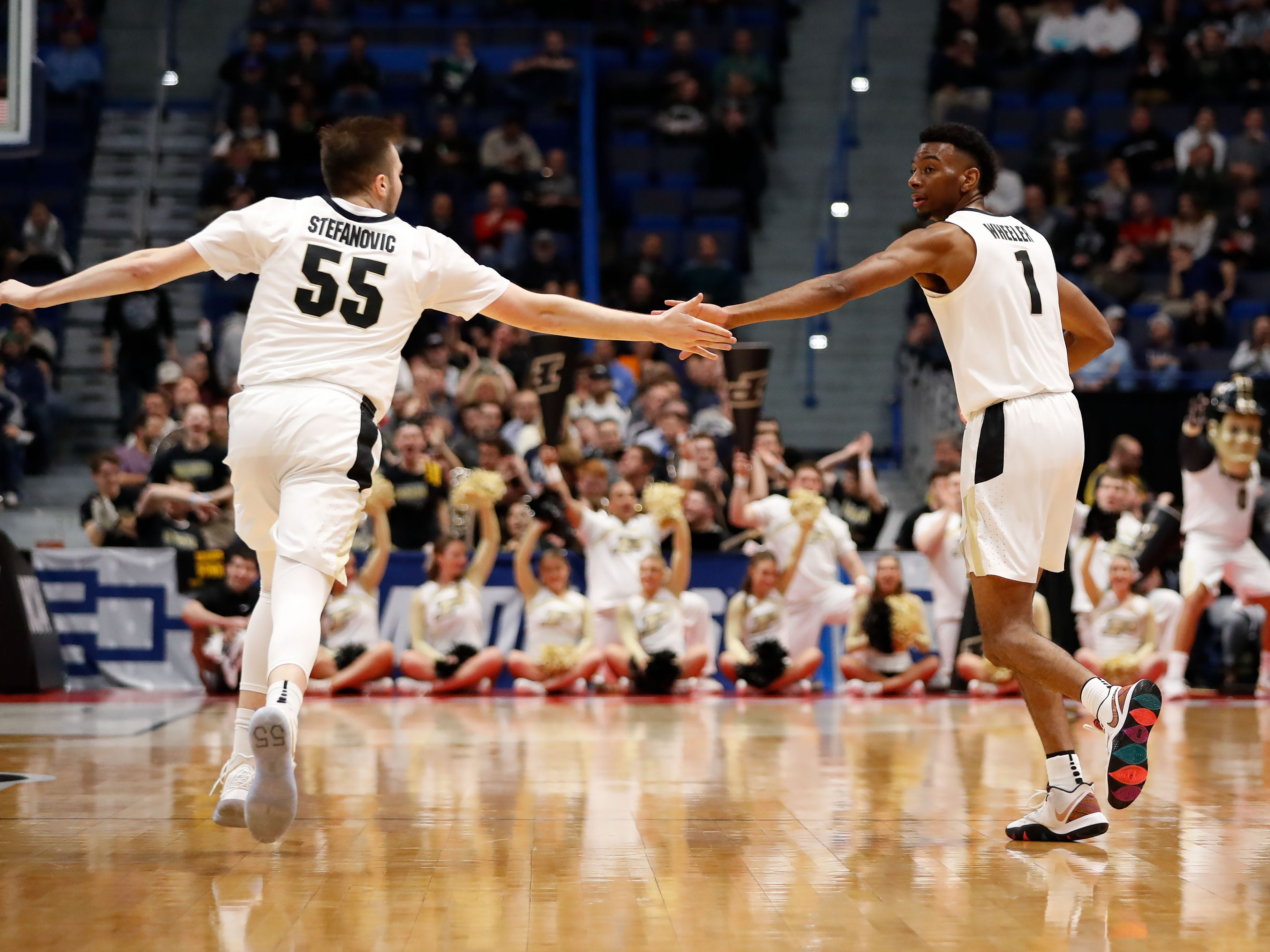 Mar 21, 2019; Hartford, CT, USA; Purdue Boilermakers guard Sasha Stefanovic (55) and forward Aaron Wheeler (1) high five during the first half of a game against the Old Dominion Monarchs in the first round of the 2019 NCAA Tournament at XL Center. Mandatory Credit: David Butler II-USA TODAY Sports