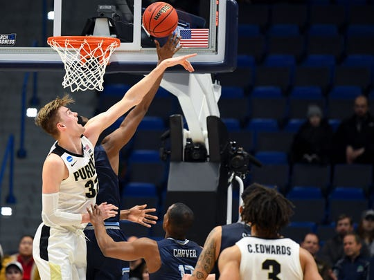 Mar 21, 2019; Hartford, CT, USA; Purdue Boilermakers center Matt Haarms (32) blocks a shot from Old Dominion Monarchs forward Dajour Dickens (23) during the second half of a game in the first round of the 2019 NCAA Tournament at XL Center. Mandatory Credit: Robert Deutsch-USA TODAY Sports