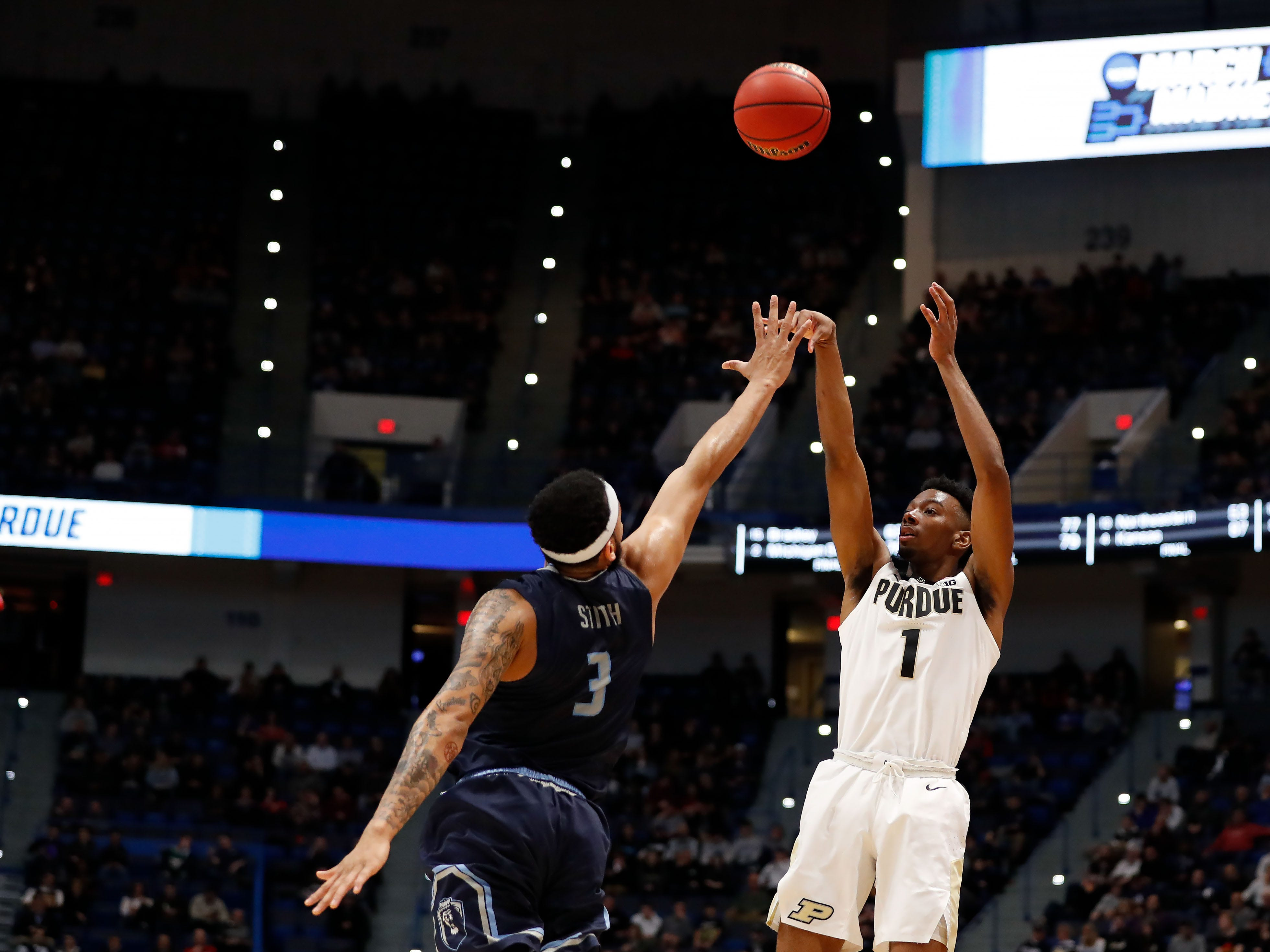 Mar 21, 2019; Hartford, CT, USA; Purdue Boilermakers forward Aaron Wheeler (1) attempts a shot over Old Dominion Monarchs guard B.J. Stith (3) during the first half of a game in the first round of the 2019 NCAA Tournament at XL Center. Mandatory Credit: David Butler II-USA TODAY Sports
