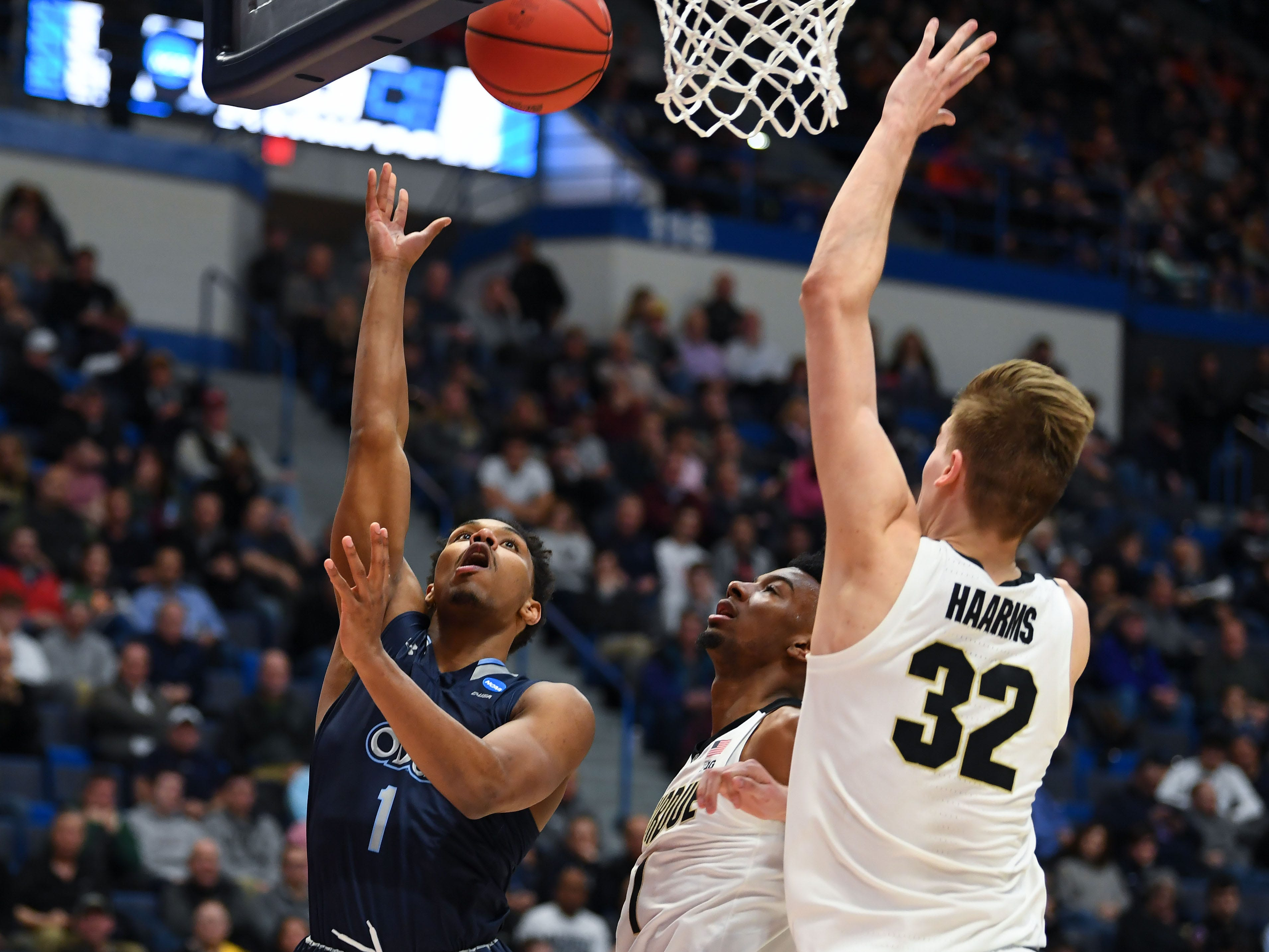 Mar 21, 2019; Hartford, CT, USA; Old Dominion Monarchs guard Jason Wade (1) attempts a layup in front of Purdue Boilermakers center Matt Haarms (32) during the first half of a game in the first round of the 2019 NCAA Tournament at XL Center. Mandatory Credit: Robert Deutsch-USA TODAY Sports