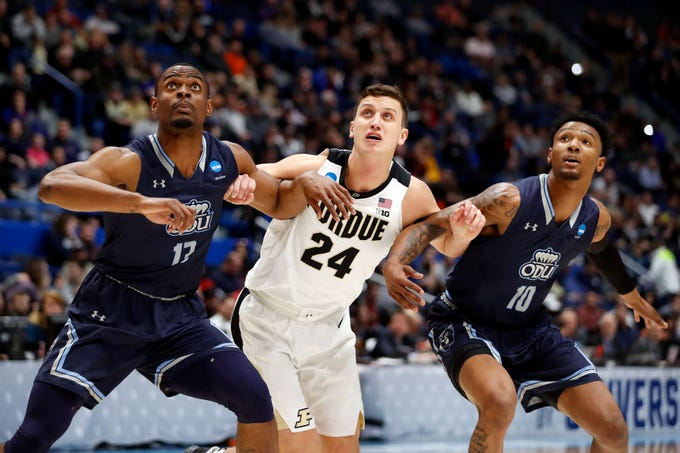 Mar 21, 2019; Hartford, CT, USA; Purdue Boilermakers forward Grady Eifert (24) watches a free throw in between Old Dominion Monarchs guard Xavier Green (10) and forward Aaron Carver (13) during the first half of a game in the first round of the 2019 NCAA Tournament at XL Center. Mandatory Credit: David Butler II-USA TODAY Sports