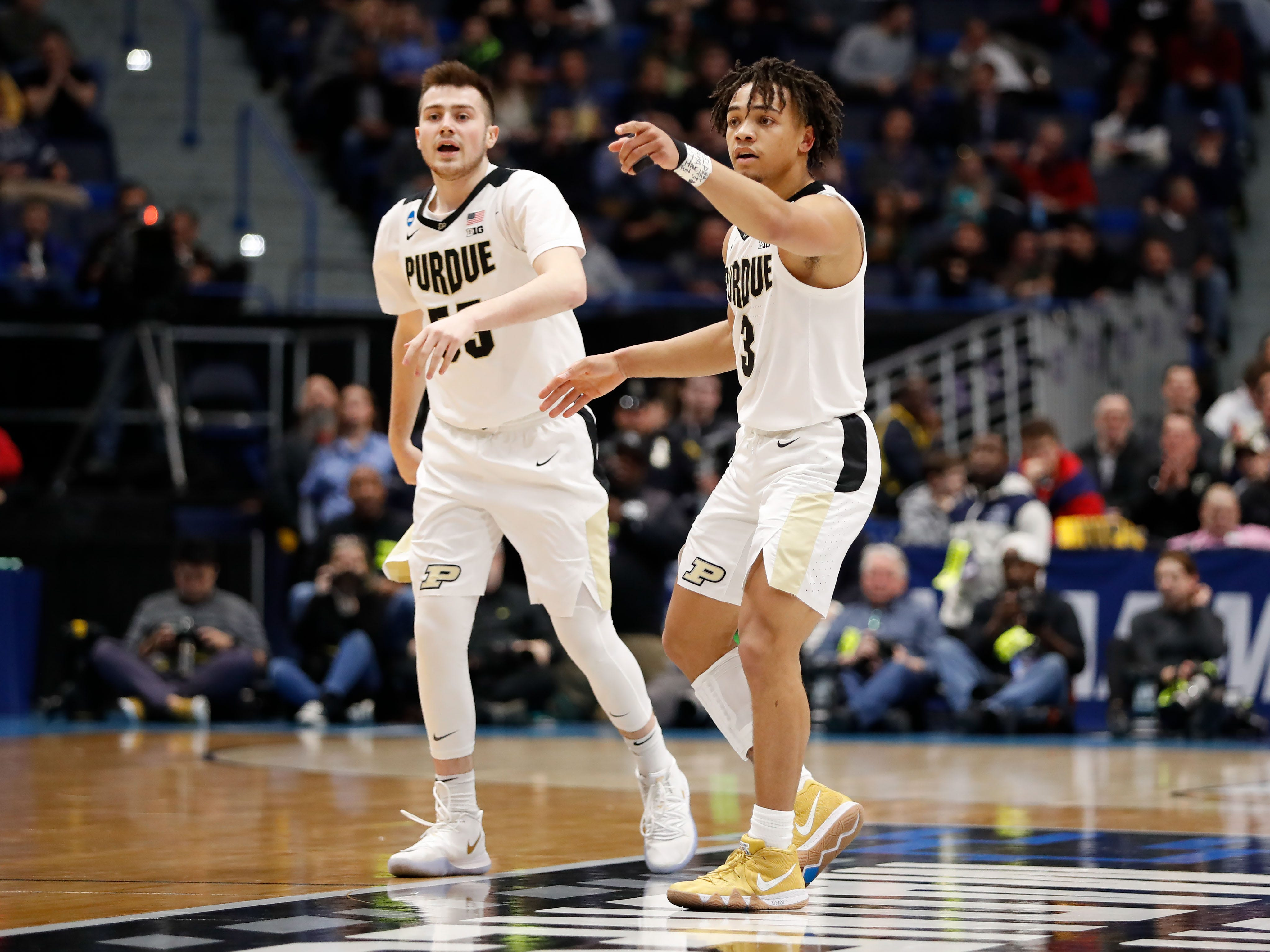 Mar 21, 2019; Hartford, CT, USA; Purdue Boilermakers guard Carsen Edwards (3) talks over a play with guard Sasha Stefanovic (55) against the Old Dominion Monarchs during the first half of a game in the first round of the 2019 NCAA Tournament at XL Center. Mandatory Credit: David Butler II-USA TODAY Sports