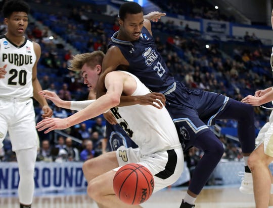Old Dominion's Dajour Dickens (23) and Purdue's Matt Haarms compete for a rebound as Purdue's Nojel Eastern (20) watches during the second half of a first-round game in the NCAA men's college basketball tournament Thursday, March 21, 2019, in Hartford, Conn. Purdue won 61-48.