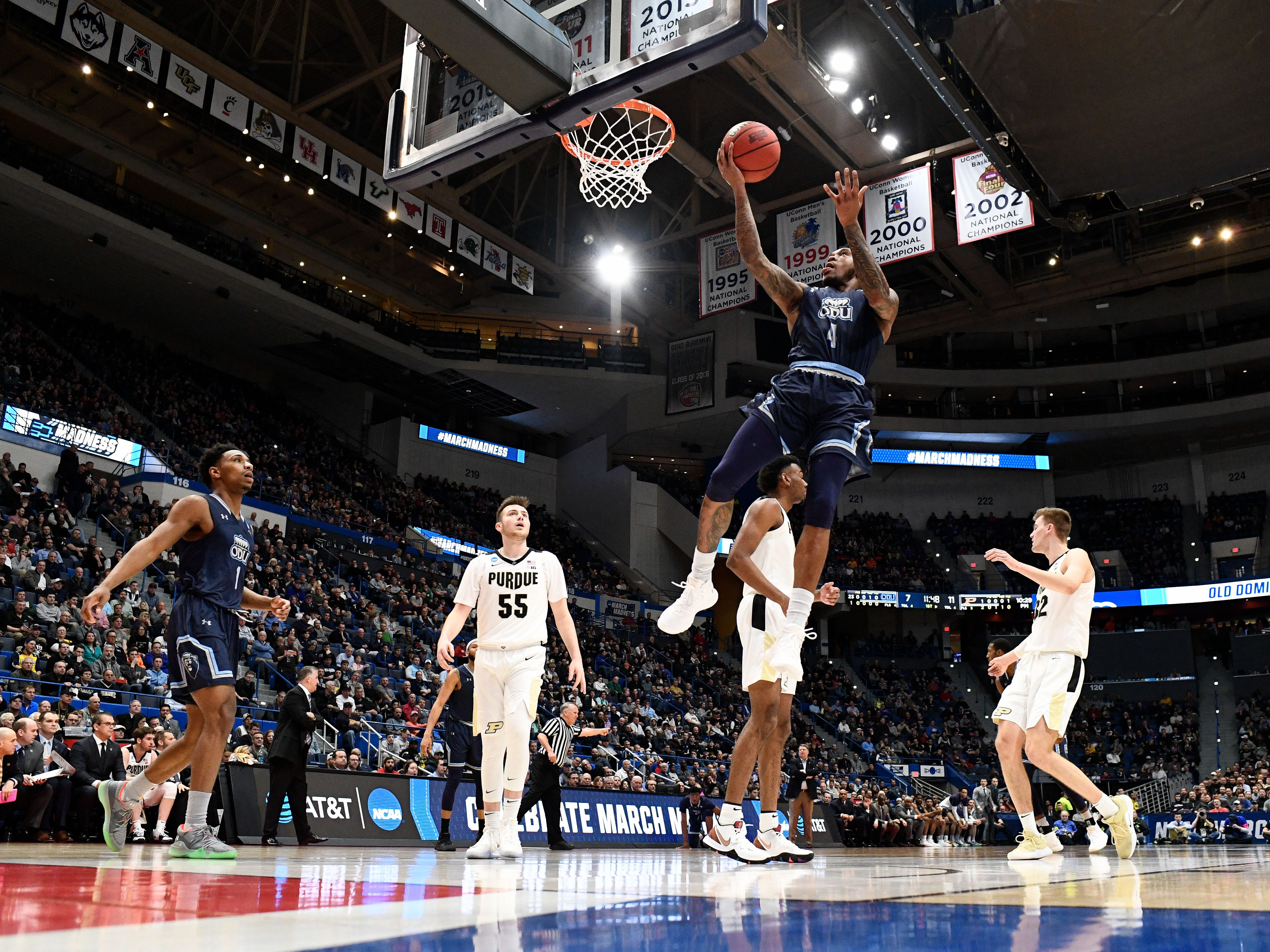 Mar 21, 2019; Hartford, CT, USA; Old Dominion Monarchs guard Ahmad Caver (4) attempts a shot against the Purdue Boilermakers during the first half of a game in the first round of the 2019 NCAA Tournament at XL Center. Mandatory Credit: Robert Deutsch-USA TODAY Sports