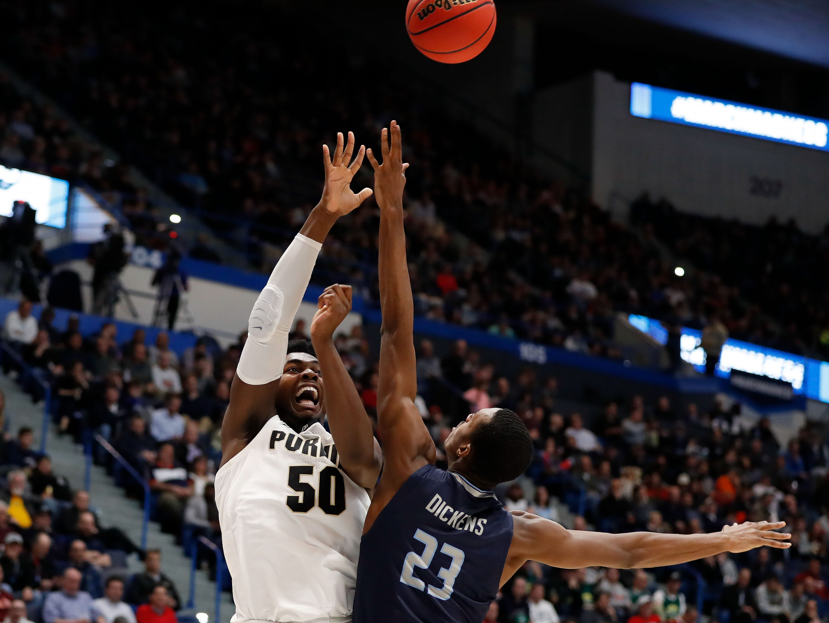 Mar 21, 2019; Hartford, CT, USA; Purdue Boilermakers forward Trevion Williams (50) attempts a shot past Old Dominion Monarchs forward Dajour Dickens (23) during the first half of a game in the first round of the 2019 NCAA Tournament at XL Center. Mandatory Credit: David Butler II-USA TODAY Sports