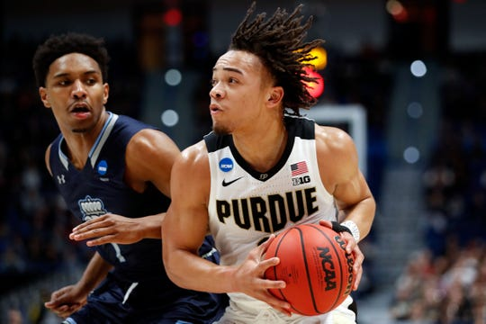 Mar 21, 2019; Hartford, CT, USA; Purdue Boilermakers guard Carsen Edwards (3) drives with the ball against Old Dominion Monarchs guard Jason Wade (1) during the first half of a game in the first round of the 2019 NCAA Tournament at XL Center. Mandatory Credit: David Butler II-USA TODAY Sports