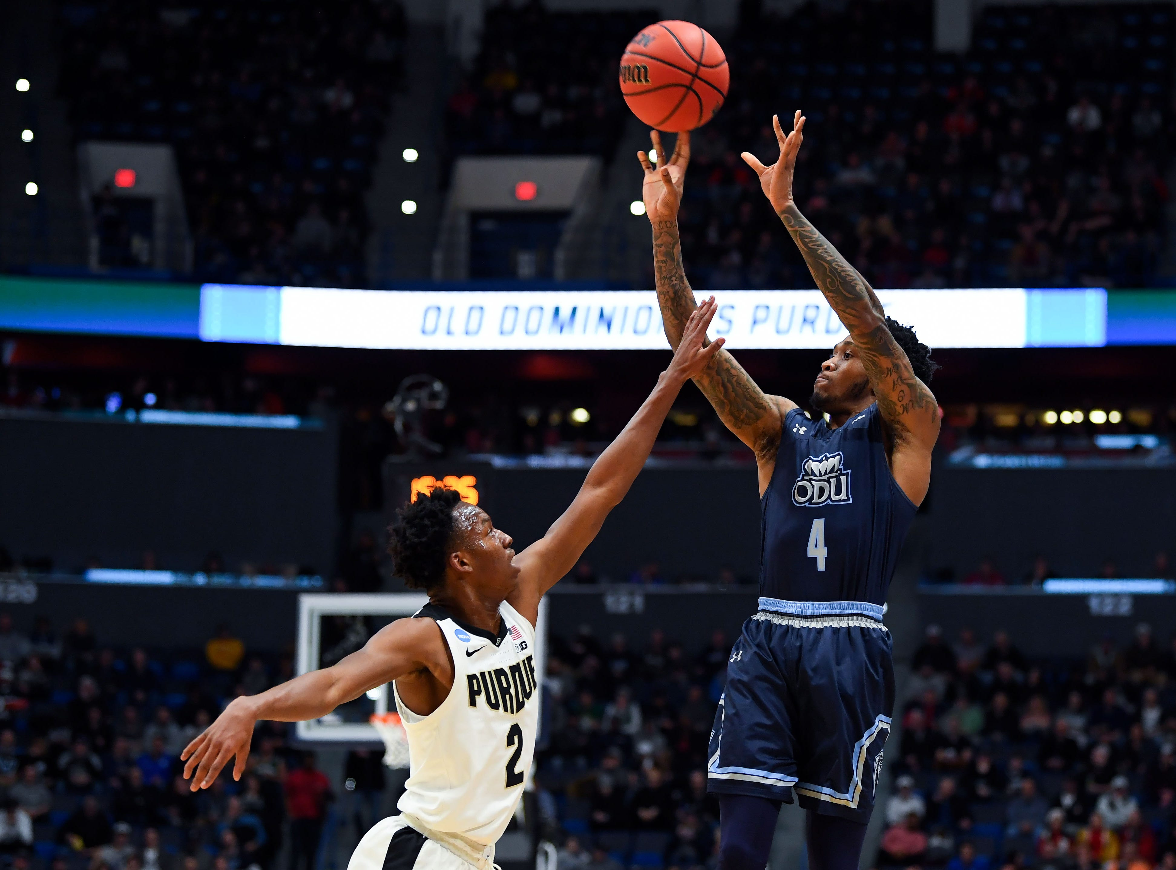 Mar 21, 2019; Hartford, CT, USA; Old Dominion Monarchs guard Ahmad Caver (4) attempts a shot over Purdue Boilermakers guard Eric Hunter Jr. (2) during the first half of a game in the first round of the 2019 NCAA Tournament at XL Center. Mandatory Credit: Robert Deutsch-USA TODAY Sports