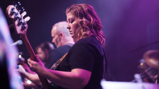 """Brittany Rees, bass player for Lafayette band Frank Muffin, performs at Lafayette Theater in December 2018, during the band's track-for-track rendition of Pink Floyd's """"The Wall,"""" featuring dozens of guest players. In 2017, Frank Muffin assembled an orchestra to perform The Beatles' """"Sgt. Pepper's Lonely Hearts Club Band."""" The band plans another album cover show again in 2019."""