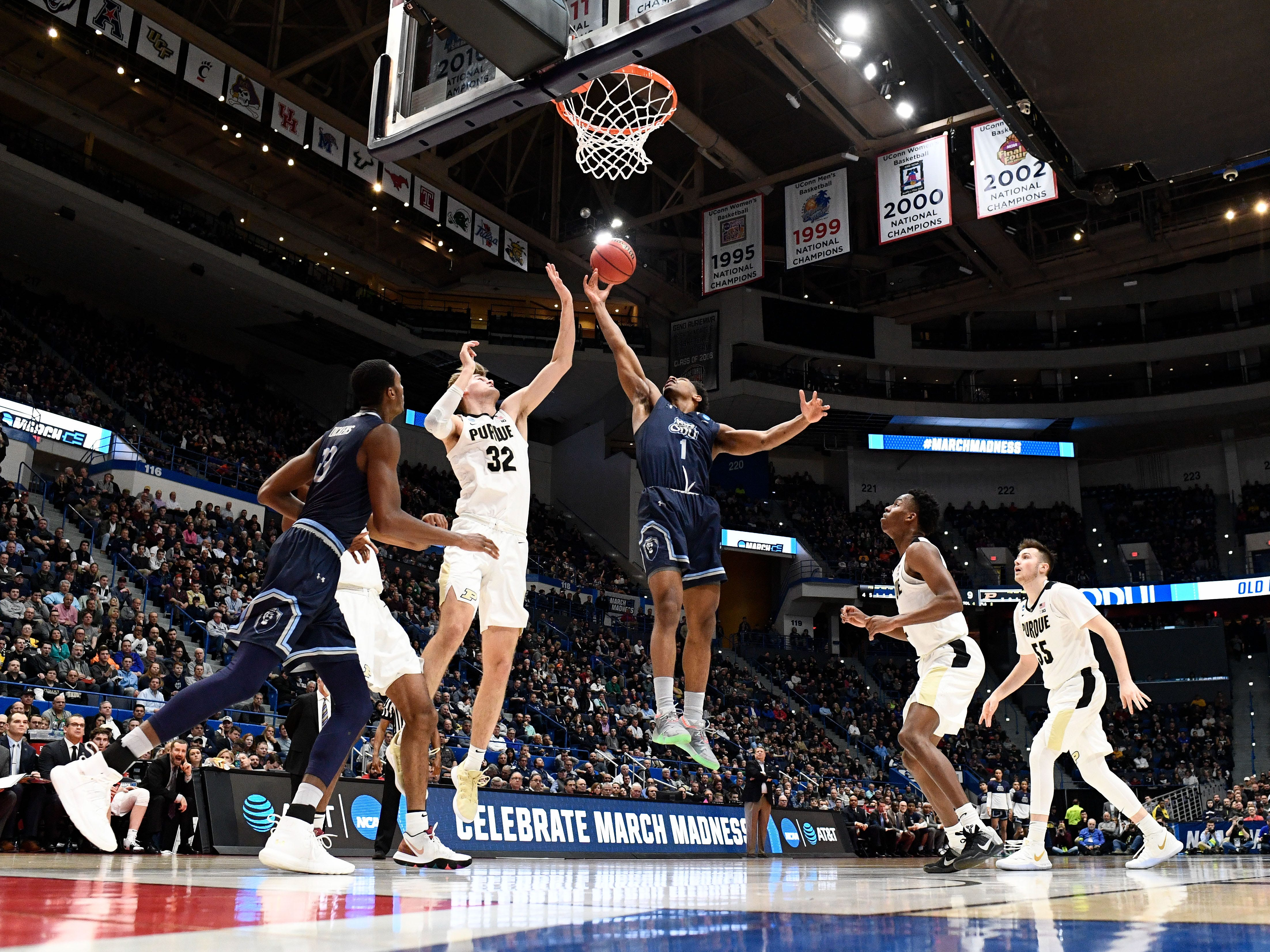 Mar 21, 2019; Hartford, CT, USA; Old Dominion Monarchs guard Jason Wade (1) and Purdue Boilermakers center Matt Haarms (32) reach for a rebound during the first half of a game in the first round of the 2019 NCAA Tournament at XL Center. Mandatory Credit: Robert Deutsch-USA TODAY Sports