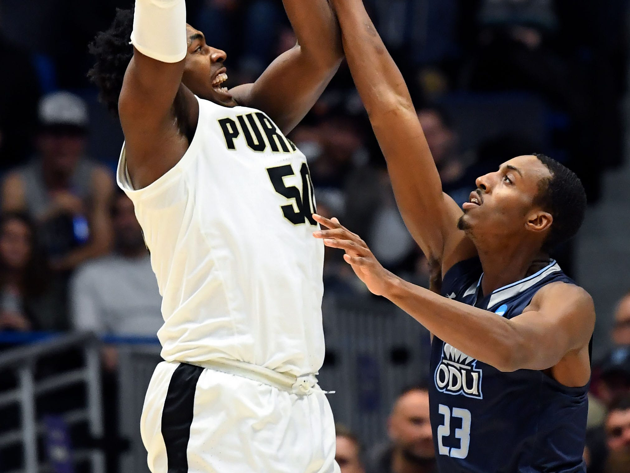 Mar 21, 2019; Hartford, CT, USA; Purdue Boilermakers forward Trevion Williams (50) attempts a shot past Old Dominion Monarchs forward Dajour Dickens (23) during the first half of a game in the first round of the 2019 NCAA Tournament at XL Center. Mandatory Credit: Robert Deutsch-USA TODAY Sports