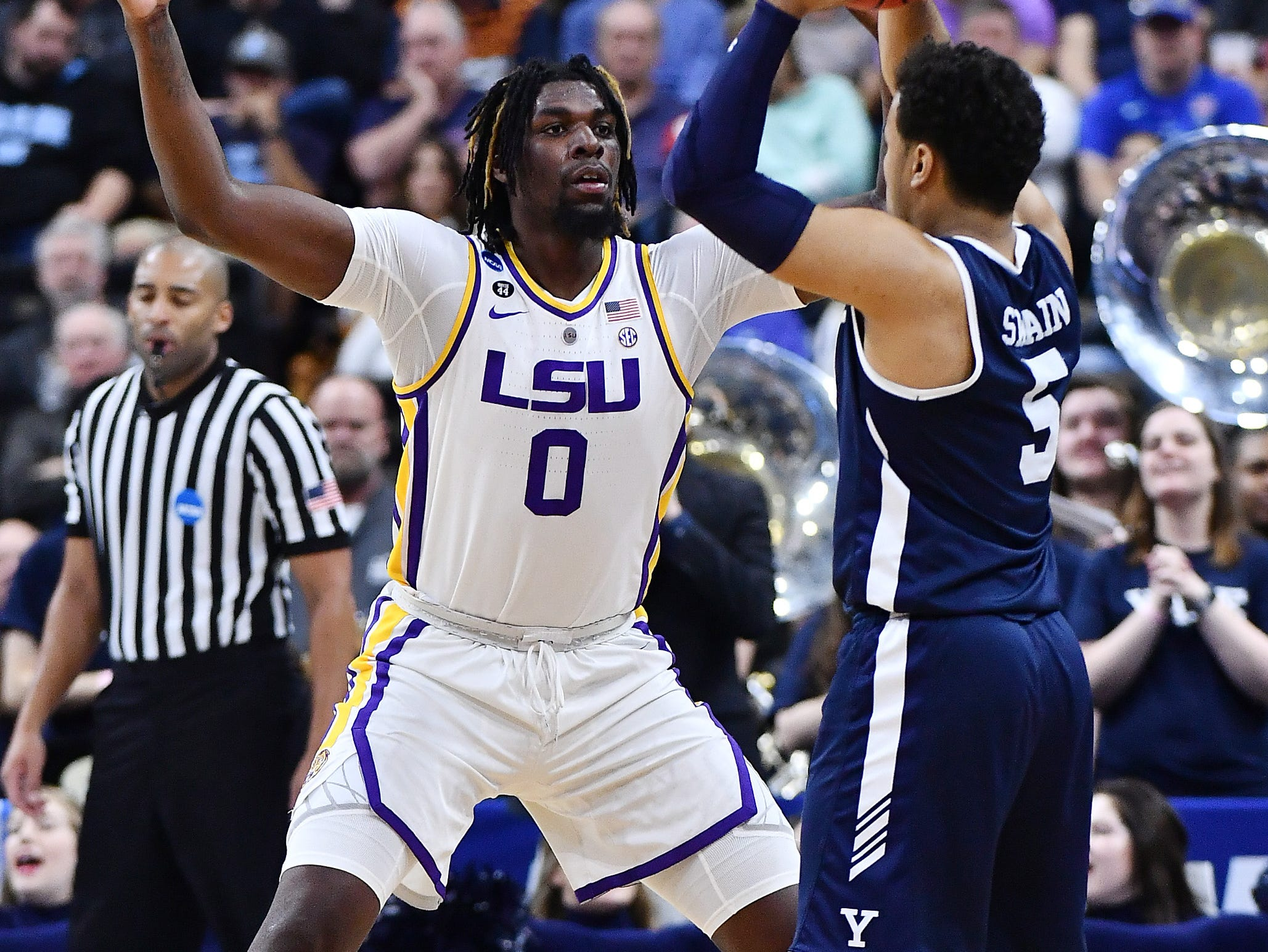 Mar 21, 2019; Jacksonville, FL, USA; LSU Tigers forward Naz Reid (0) pressures Yale Bulldogs guard Azar Swain (5) during the second half in the first round of the 2019 NCAA Tournament at Jacksonville Veterans Memorial Arena. Mandatory Credit: John David Mercer-USA TODAY Sports