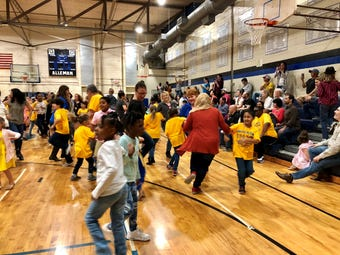 Woodvale Elementary students, family and teachers dance together and celebrate Music Week with Family Folk Dance Night Thursday, March 21.