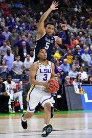 Mar 21, 2019; Jacksonville, FL, USA; LSU Tigers guard Tremont Waters (3) drives against Yale Bulldogs guard Azar Swain (5) during the second half in the first round of the 2019 NCAA Tournament at Jacksonville Veterans Memorial Arena. Mandatory Credit: John David Mercer-USA TODAY Sports