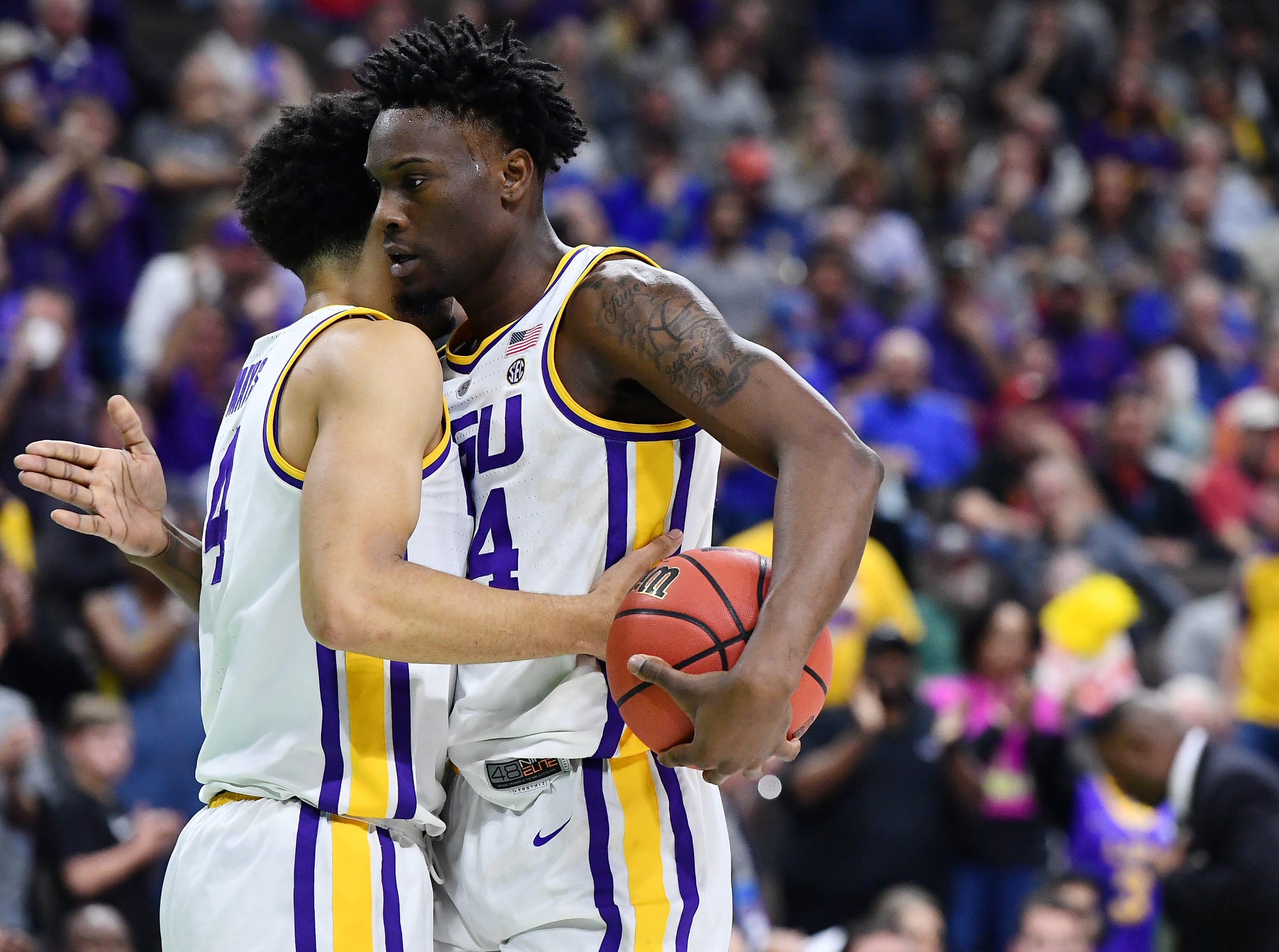 Mar 21, 2019; Jacksonville, FL, USA; LSU Tigers guard Skylar Mays (4) and forward Emmitt Williams (24) react during the second half against the Yale Bulldogs in the first round of the 2019 NCAA Tournament at Jacksonville Veterans Memorial Arena. Mandatory Credit: John David Mercer-USA TODAY Sports