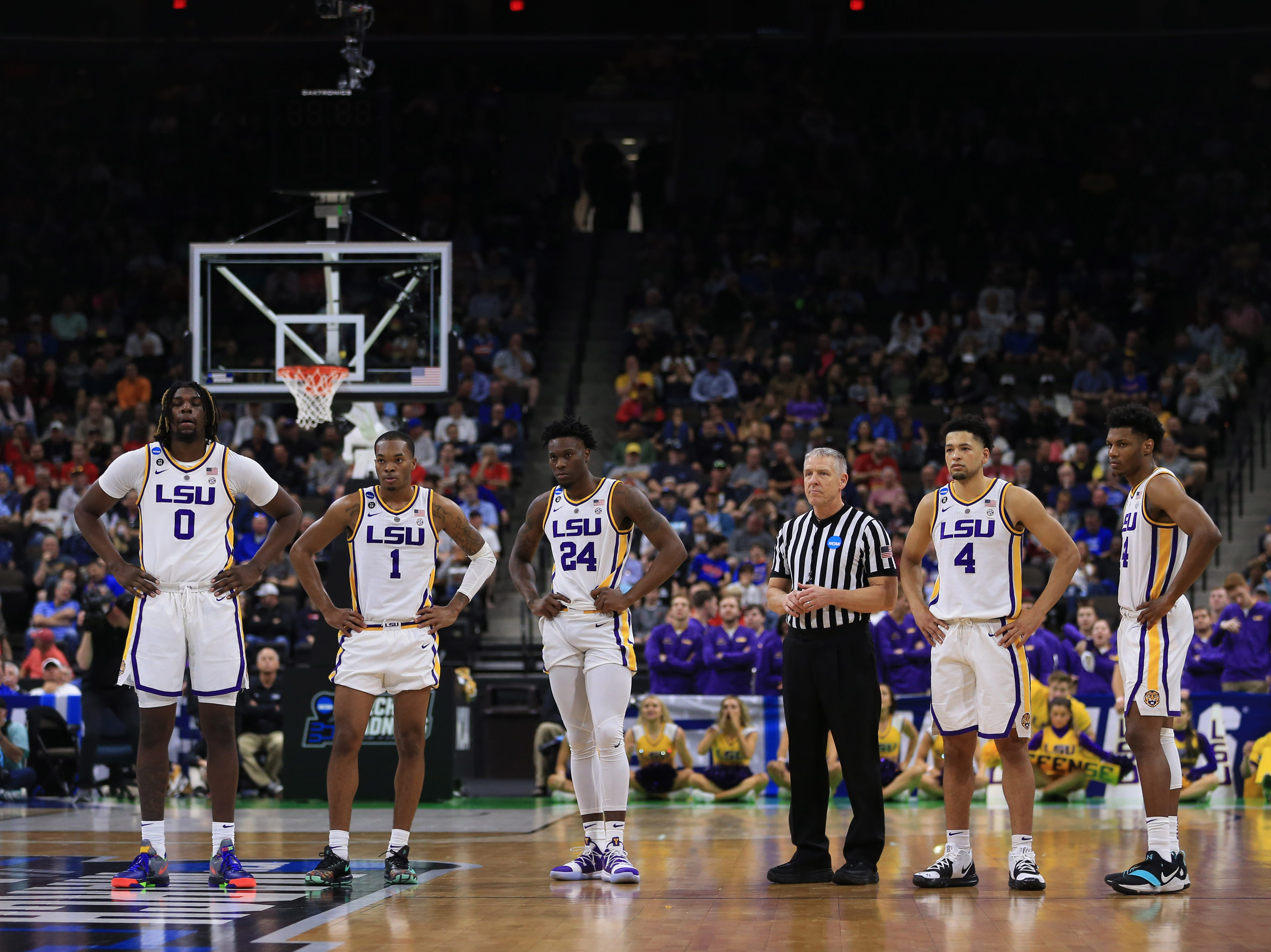 Mar 21, 2019; Jacksonville, FL, USA; The LSU Tigers look on a Yale Bulldogs guard Alex Copeland (not pictured) shoots a free throw for a technical foul at LSU guard Javonte Smart (1) during the second half in the first round of the 2019 NCAA Tournament at Jacksonville Veterans Memorial Arena. Mandatory Credit: Matt Stamey-USA TODAY Sports